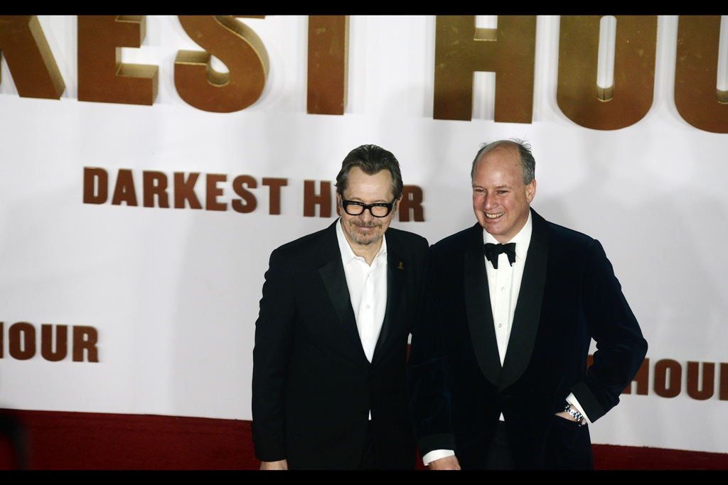 Randolph Churchill stands at right... but Gary Oldman, like that urban myth about some animals not having the ability to look up.... appears not to have the ability to look up. If he's accomplished all he has without that skill, them more props to him.