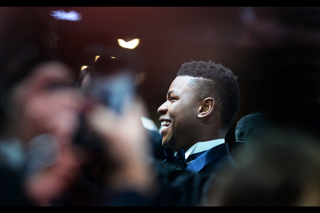 John Boyega was by far and away the most cheerful star on the red carpet.