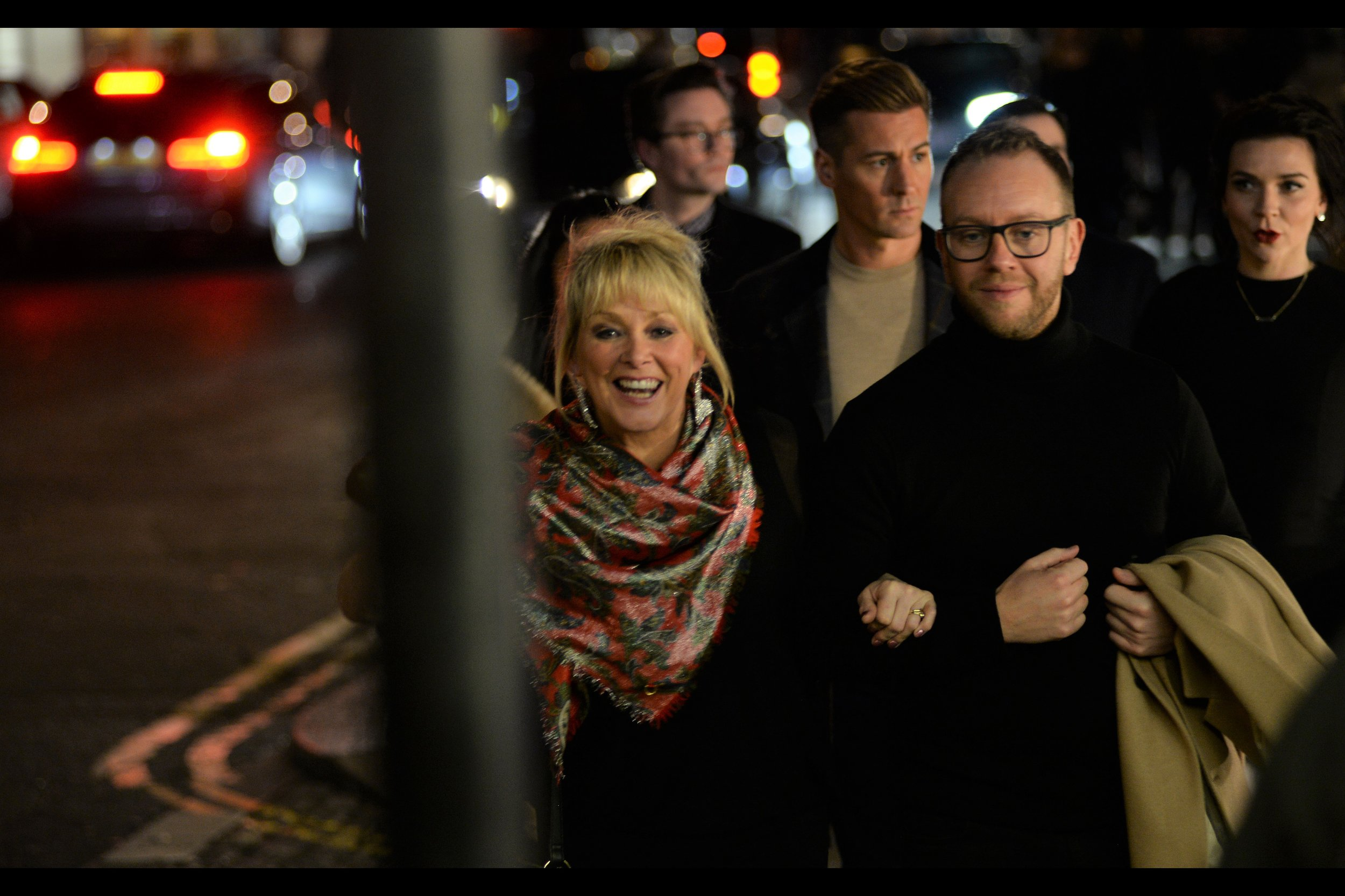 Cheryl Baker is from the band 'Bucks Fizz', who won Eurovision in 1981. The scarf is fantastic too (it's London Fashion week as of today, so I feel obliged to point this out)