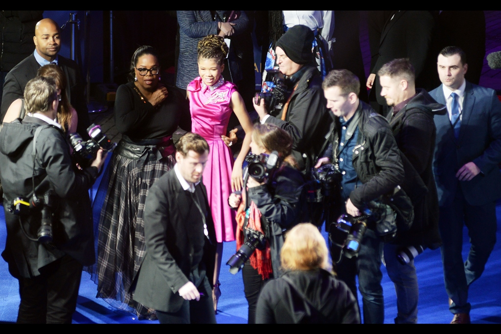 """All of a sudden perhaps I'm wondering whether one or both of us should have tried to co-ordinate dresses...""  Storm Reid's pink dress is an amazing contrast against the crowd and carpet"