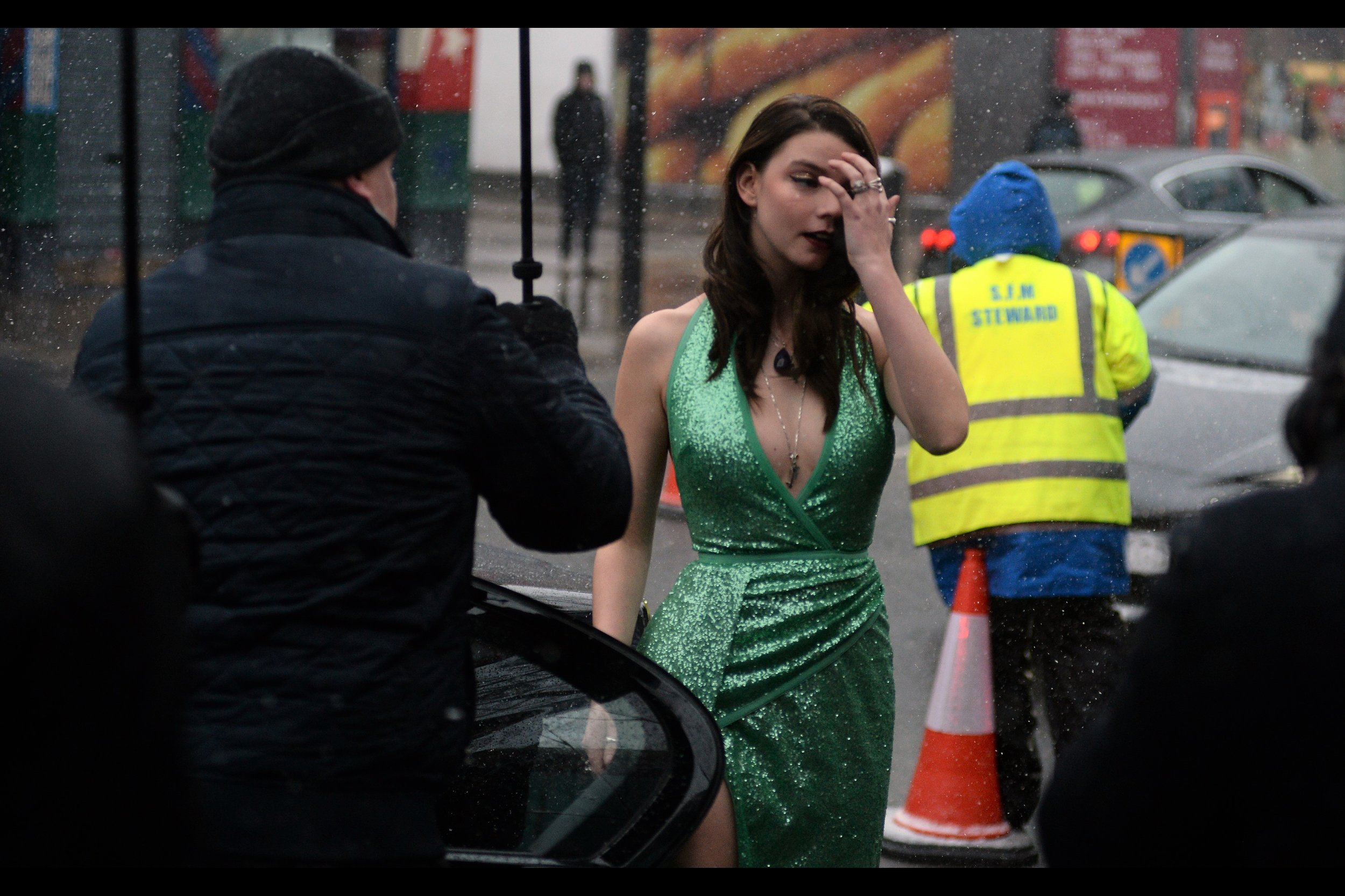 A girl can put on all the makeup, get her hair done, wear the most form-fitting and impractical cold-weather dress to a major event.... but it only takes one dude on a roadside doing his job and wearing a yellow high-viz vest over a bright blue hoodie standing next to a bright orange traffic cone to make it feel like it's all been for nought.