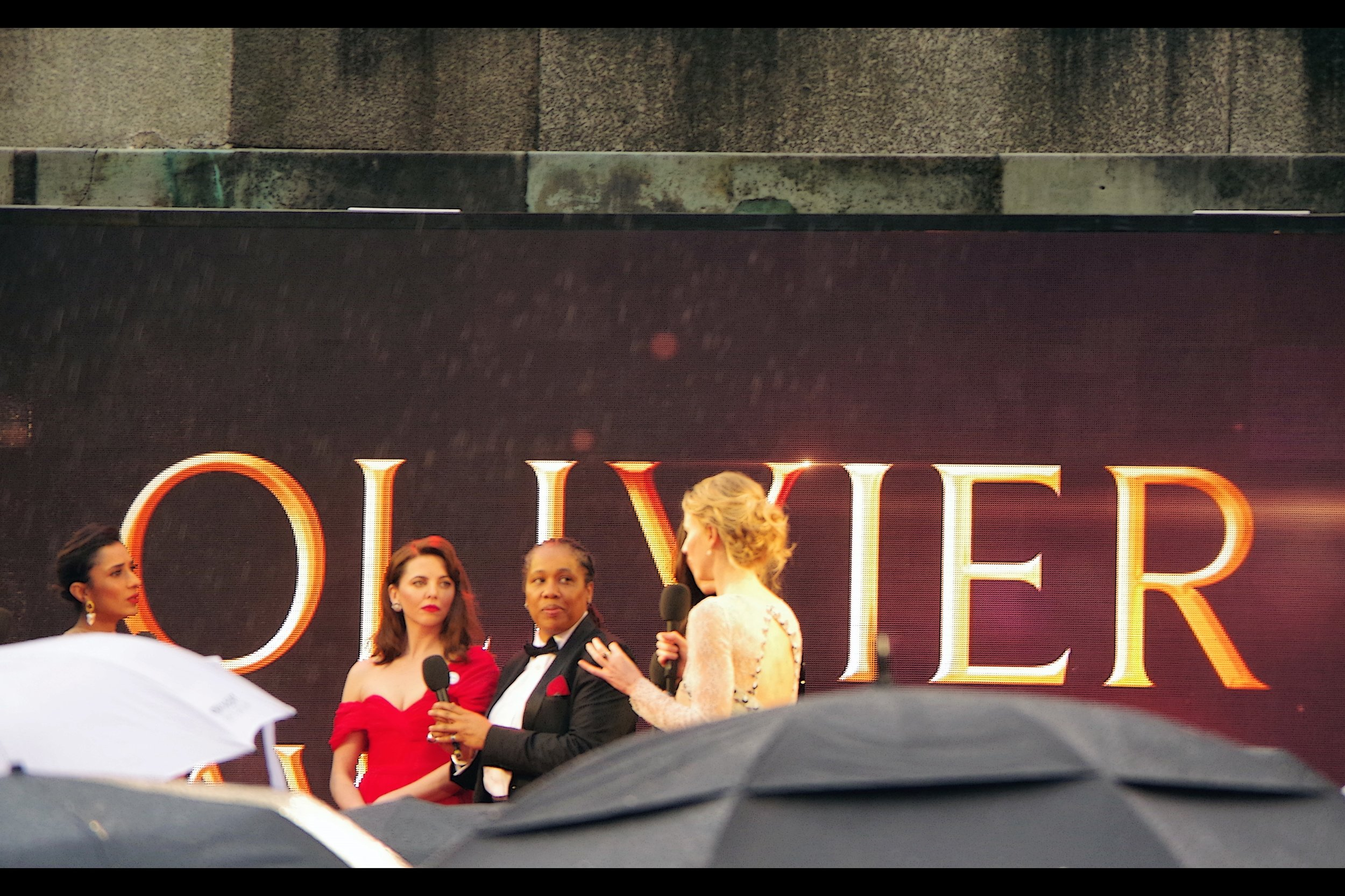 Ophelia Lovibond (in red) accepted the best supporting actress award on behalf of Denise Gough for Angels in America. She (and several actresses) it was reported brought female activists as their +1 to their event, (in her case Marai Larasi). I did not bring a female activist with me as my +1, but if it helps I do tend to think of my Nikon as being intrinsically female