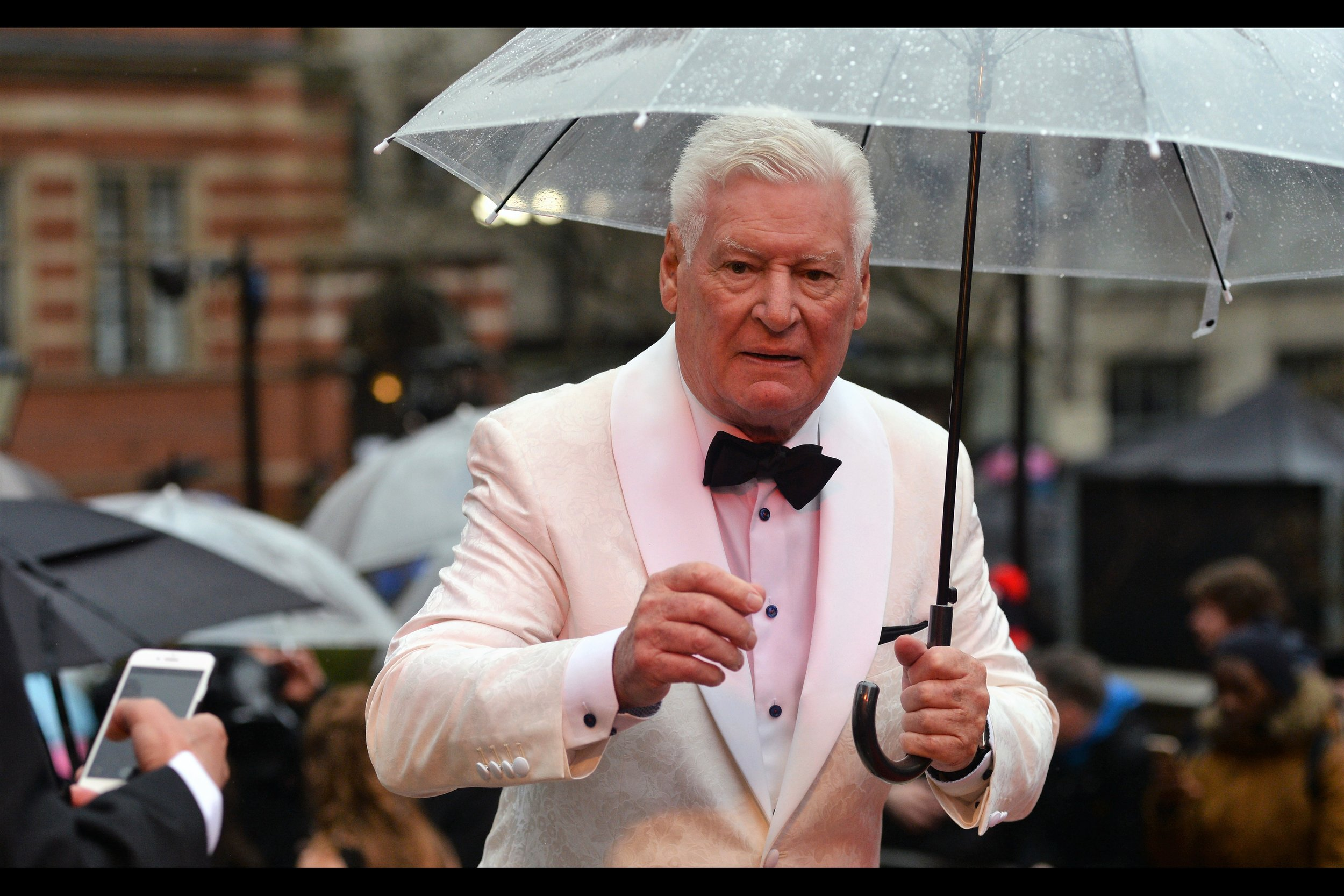 I'm given to understand that this gentleman used to host some kind of game show in the 1990s? Okay.... I'll post his photo. But only because he's wearing a white suit jacket.