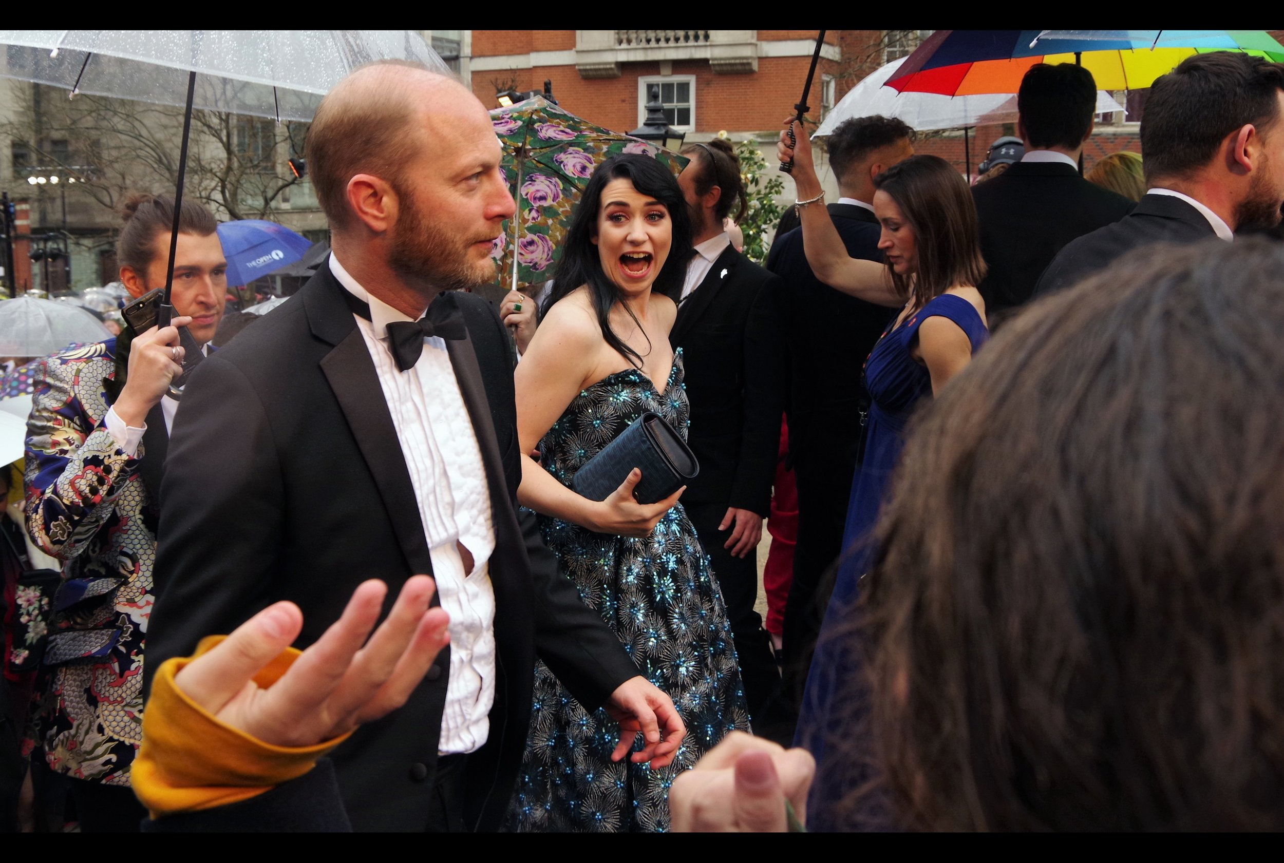 """Lady in Background :   """"OMG! I know this is theatre and I'm meant to be totally understated but that man's hand appears to be FREAKISHLY HUGE!!""""  . In other momentous news, Wireimage has finally come through for once... and identified the lady as Danielle Hope."""