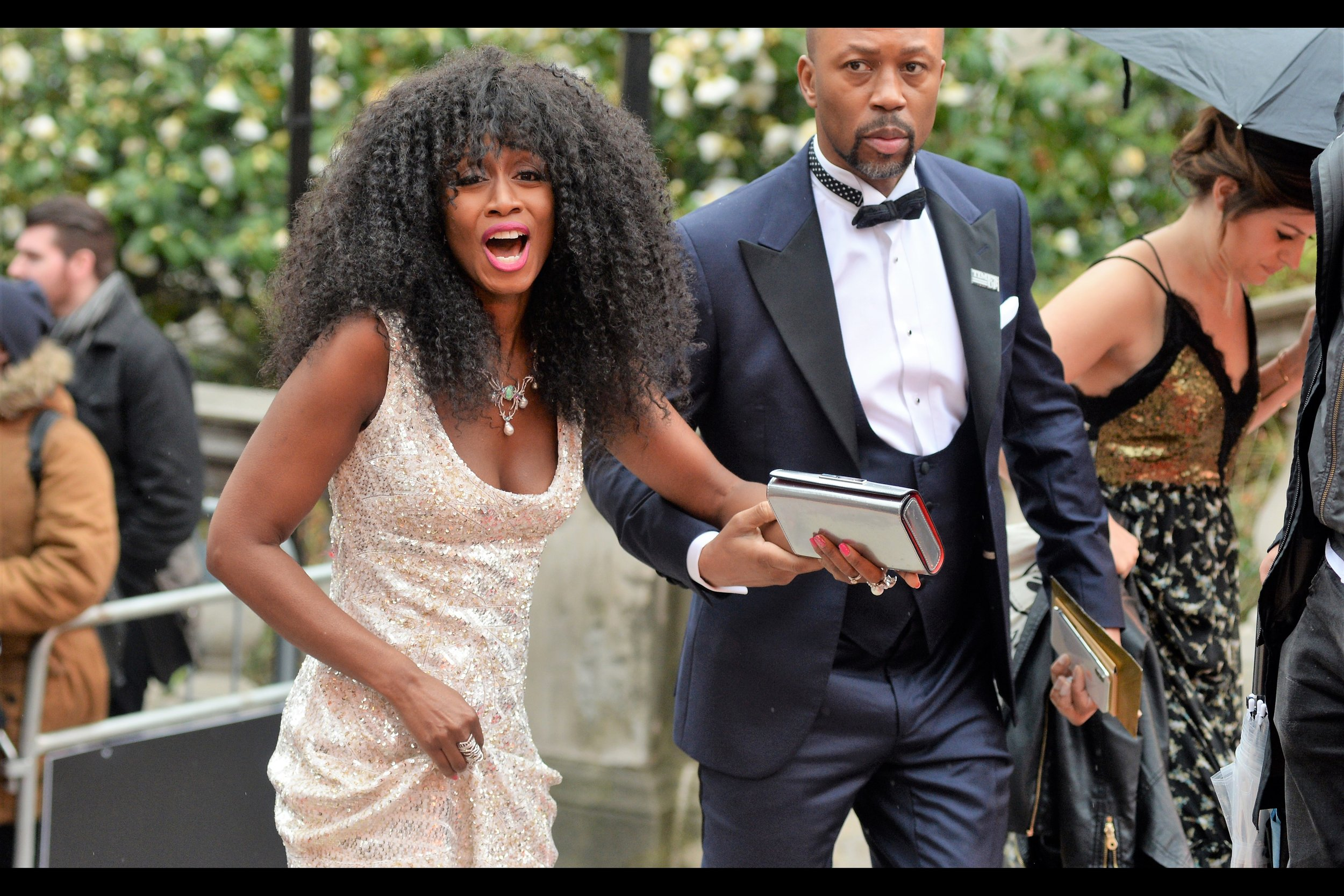 """""""It was straight when I got out of the car.... but then it rained and... well... as you can see, no way I'm going to be able to be wearing a baseball cap tonight""""  Identified as : Beverley Knight, singer."""