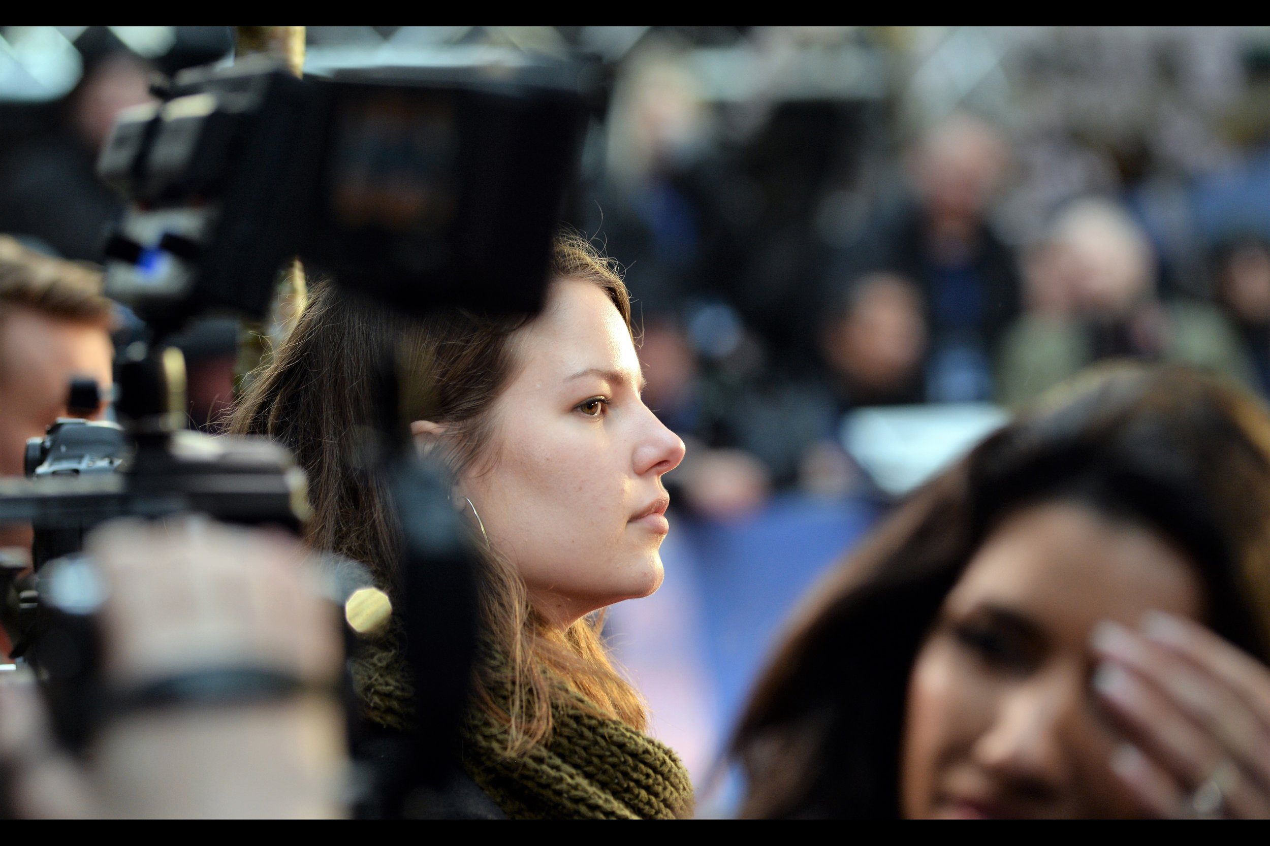 """The camera lady is certainly pretty, but from where I sit a few hours later, I almost wish I'd focussed more on the foreground, at the lady with the  """"but whatever shall I do if Michiel Huisman doesn't show up?""""  expression of imminent despair."""