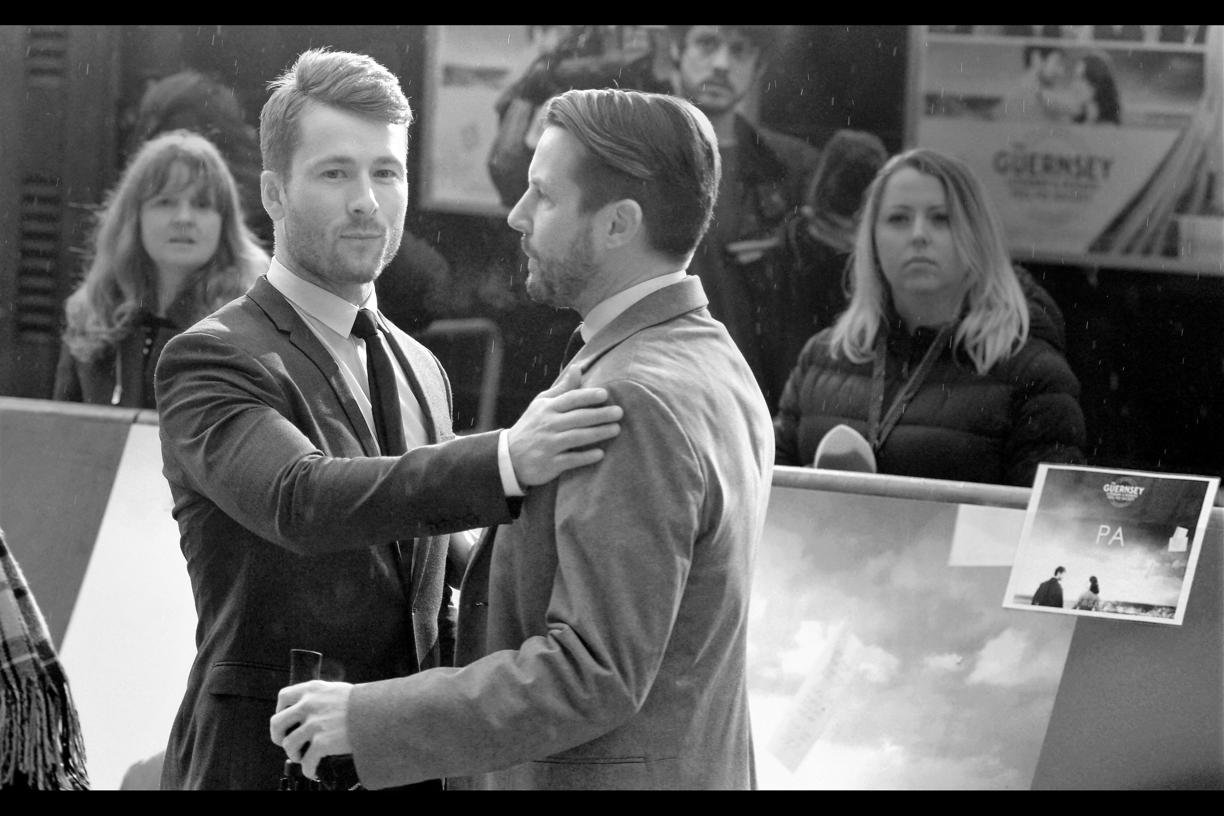 """""""Hold that thought. I think I hear an autograph dealer who needs me"""" . Glen Powell also had a role in the third Expendables film.... AND played the role of 'Trader 1' in Christopher Nolan's The Dark Knight Rises!"""