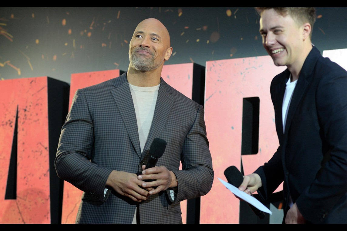 """""""He's going to stand here for another few minutes so as to inspire you all to do more with your inadequate lives.... and also give our sculptor a chance to carve his likeness into a statue that will inspire generations to come....."""" . I like Dwayne Johnson, and last photographed him in the also-   Brad-Peyton directed """"San Andreas"""""""