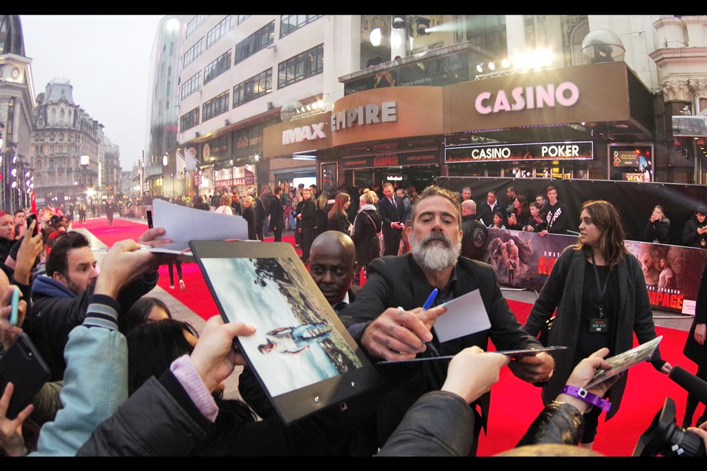 """Jeffrey Dean Morgan is still signing autographs and the dealer crush from behind matches or exceeds the crush from the side. He was also in 'Watchmen (2009)' with Malin Akerman, but is possibly more famous for his recurring role in """"The Walking Dead"""" which is highly appropriate at this premiere..."""