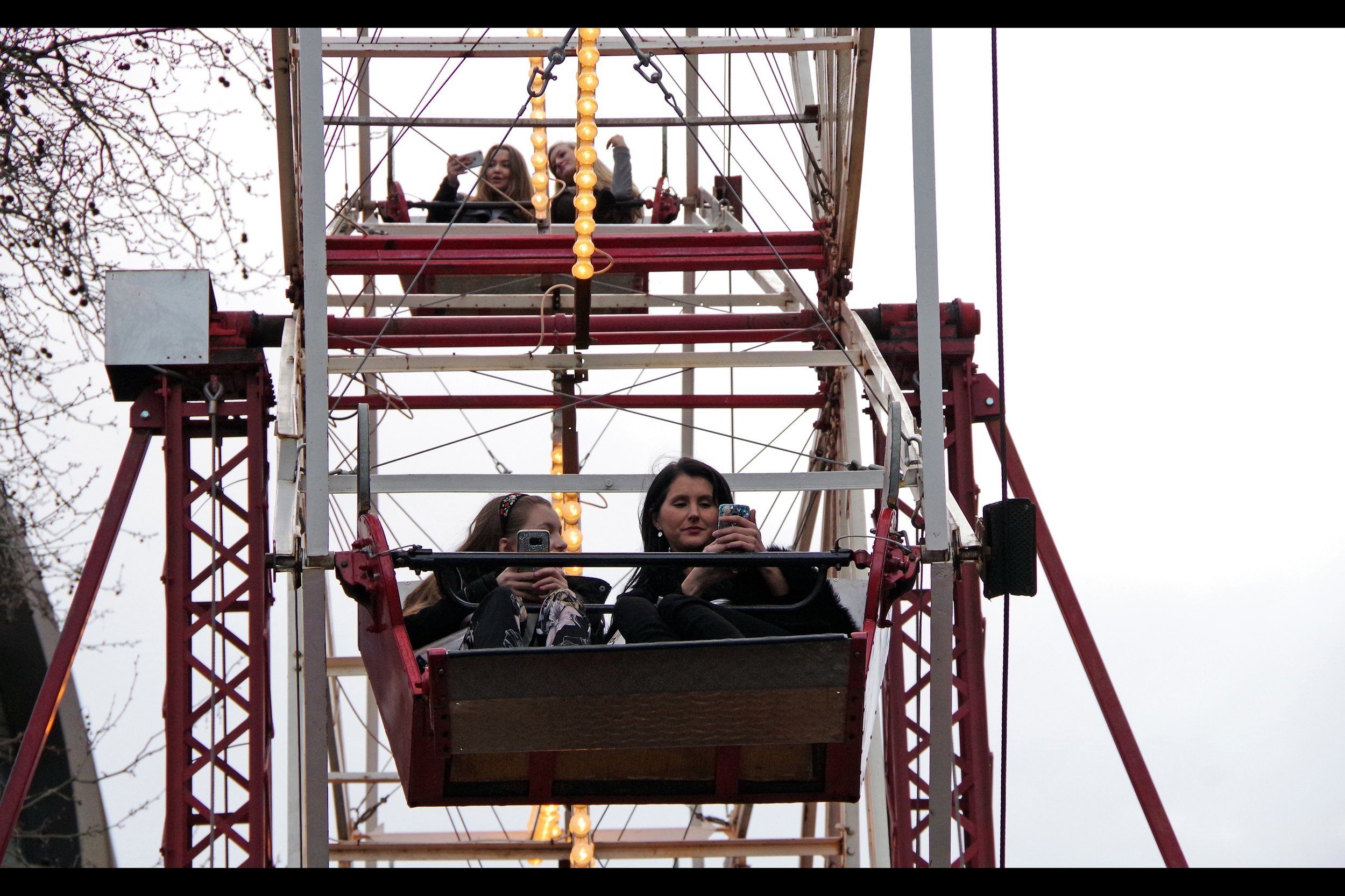 True fact : you can't ride a ferris wheel without spending most of the ride on your mobile phone texting everyone you know telling them you're on a ferris wheel. (Or taking a selfie of yourself with a grey sky behind you that it would be otherwise almost impossible to take from ground-level)