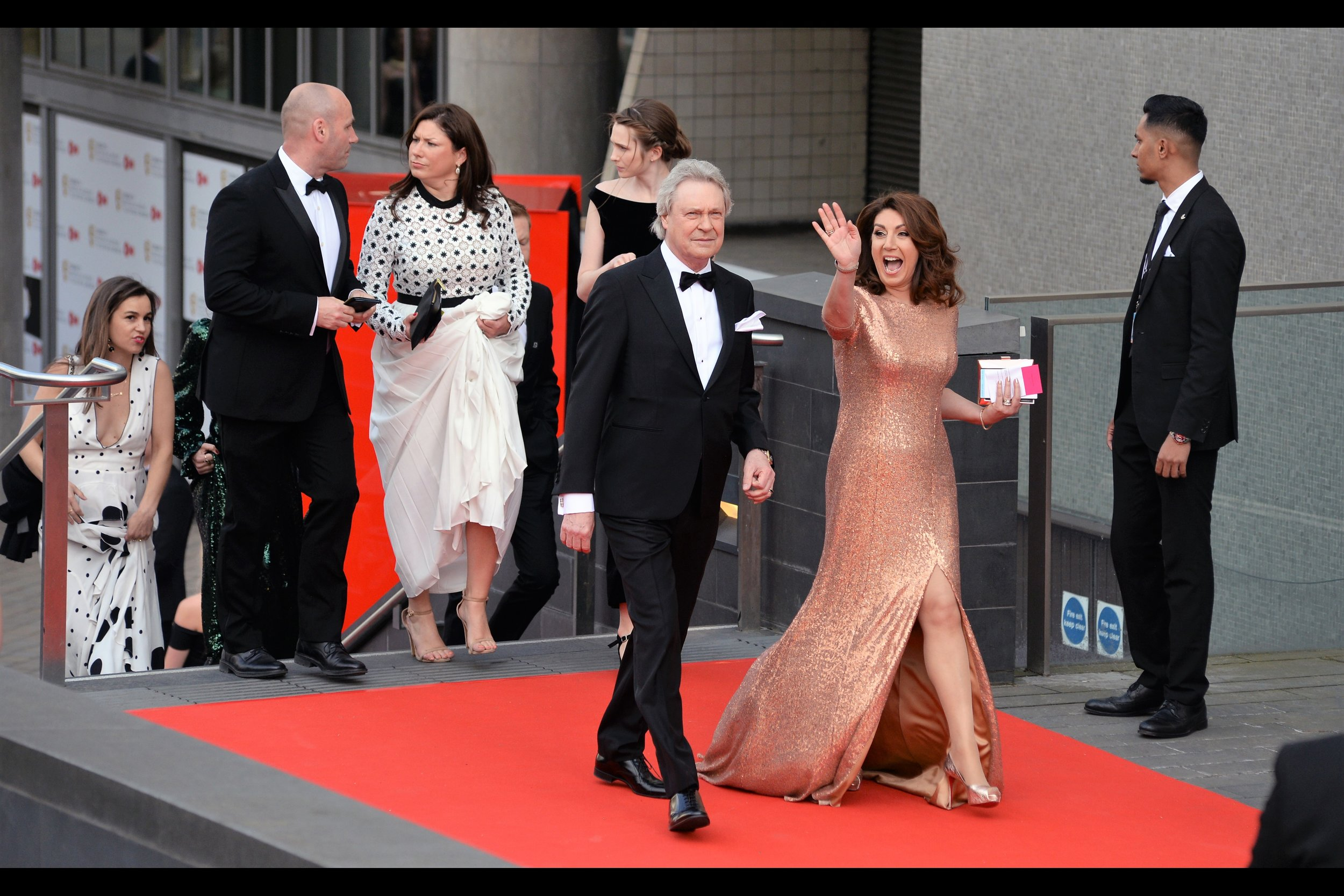 """Hi guys.. this dress is solid copper and weighs a ton and I still have another flight of stairs to go.... so let's not get all worked up about how awesome it must be to be famous"" . Sadly, I don't know who this is,but she might have a point about fame.  (edited to add : ""Jane McDonald"") (edited to edit : ""Cruising With Jane McDonald"" won the 'features' Bafta on the evening)"