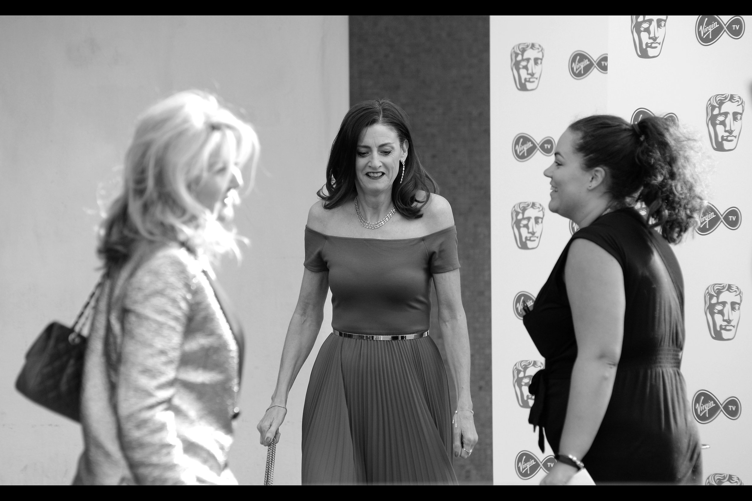 I feel like I should know who this is, since I'm about 80% certain I photographed (and probably even identified) who this was when she attended    LAST year's TV Baftas   .