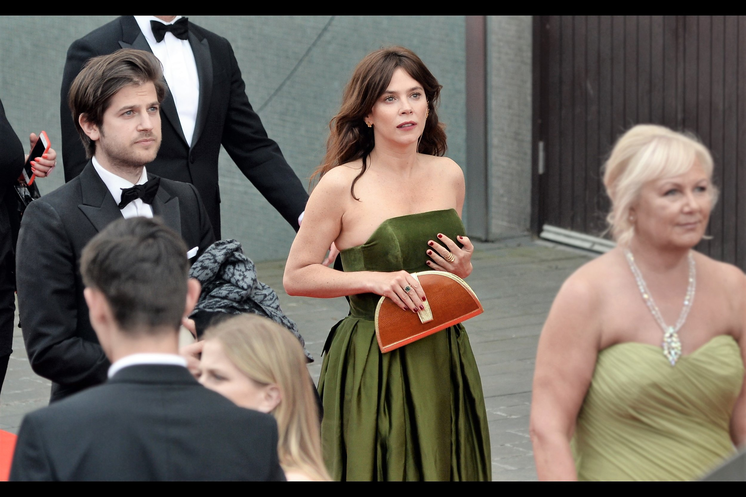 """Anna Friel's imdb filmography (I refuse to acknowledge TV shows I don't watch, even at the Baftas) reveals strange movies like """"Land of the Lost"""" with Will Ferrell, and the movie """"Timeline"""" with Paul Walker... and """"Limitless"""" with Bradley Cooper. But that shade of dress is pretty great."""