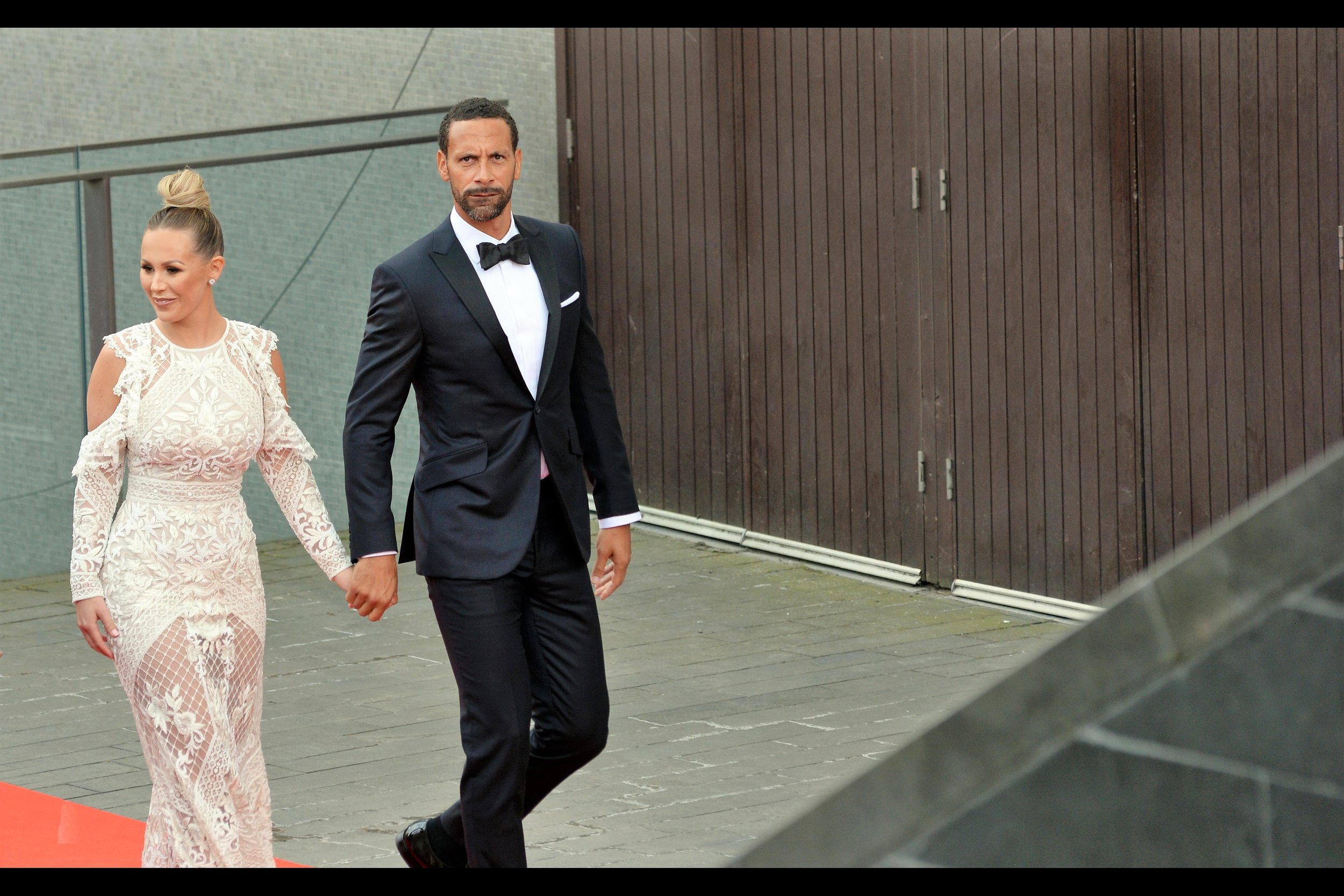 Rio Ferdinand is (I believe) a former English football (soccer) captain.  (edited to add : he won / was seen holding a Bafta for 'Single Documentary' for 'Rio Ferdinand : Being Mum and Dad')