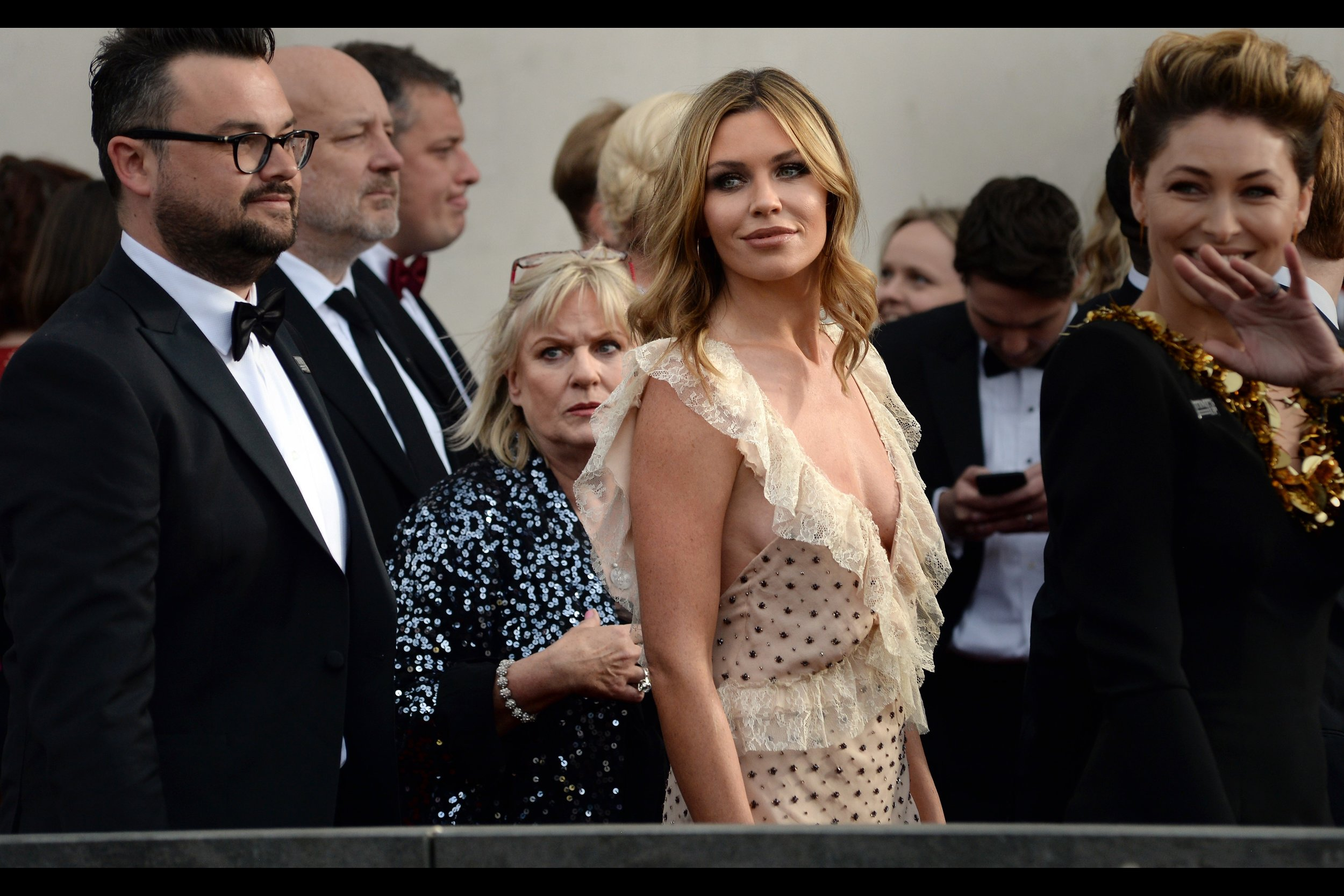 Abbey Clancey.... I think I photographed her at a GQ Awards, once. The scary/vexed looking woman behind her is not somebody I'm any more familiar with.