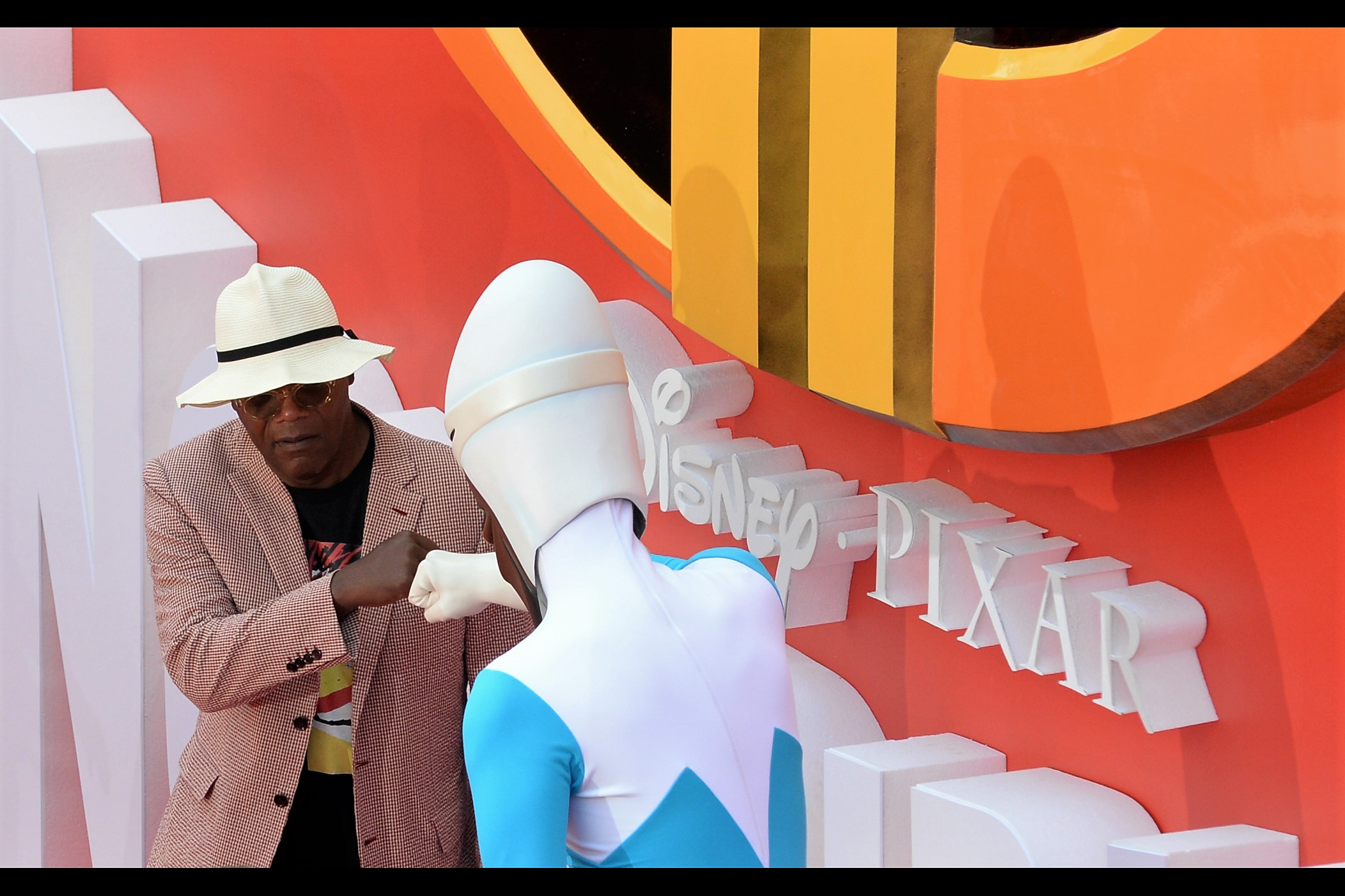"""""""One cautious fist-bump, but that's all.""""  - Samuel L Jackson meets Frozone, the voice he plays in The Incredibles."""