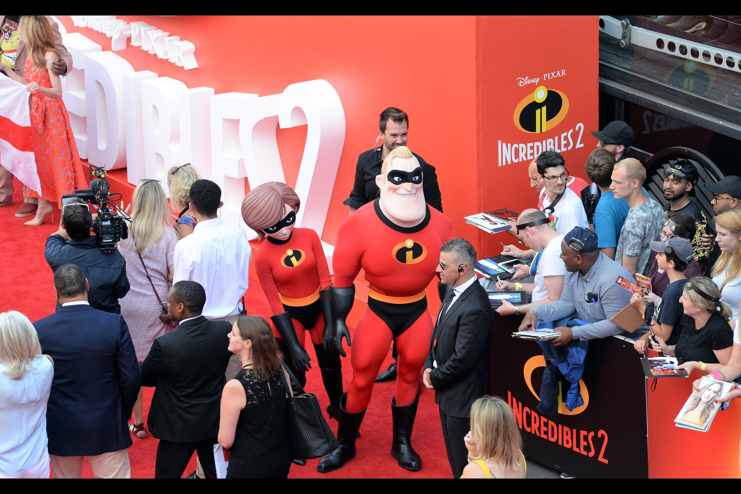 """""""I don't want to alarm you, but I think Elastigirl is starting to wilt a little in this heat..."""""""