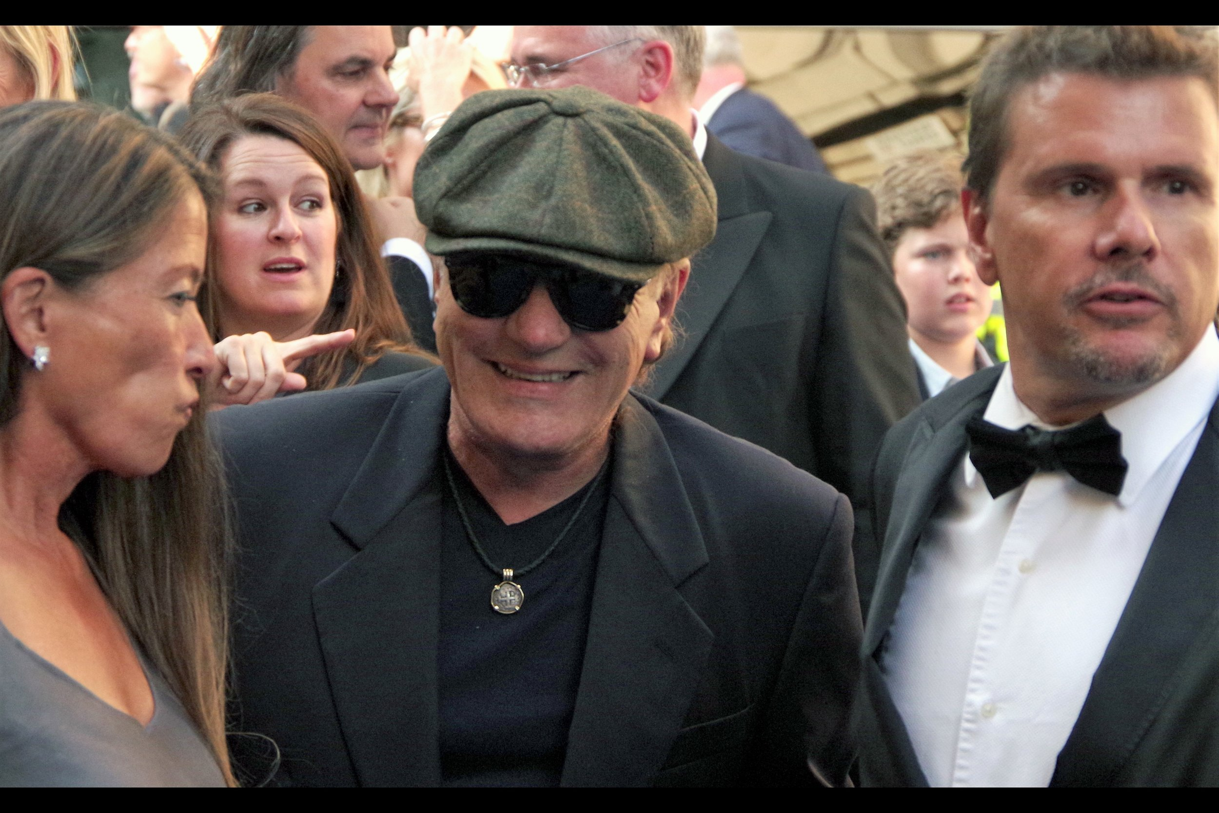 "As indicated by the finger of the woman in the background, Brian Johnson is notable as being lead singer of the band I'm cautiously claiming as ""Australia's Own"" AC/DC from 1980 to 2016."