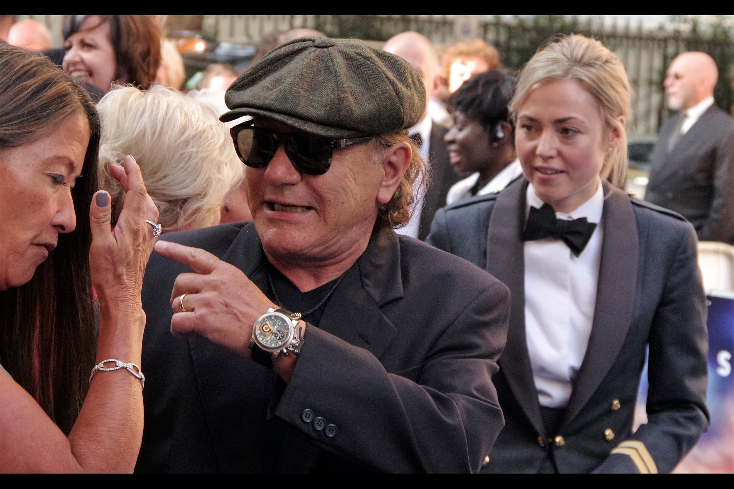 """I can point just as well as you can, ma'am""  - and in doing so, Brian Johnson shows off a rather cool RAF-inspired (?) wristwatch. And just for once I'm glad I'm ""only"" wearing a Japanese-made quartz watch rather than an even more incendiary Kienzle German Aviator watch to this premiere."