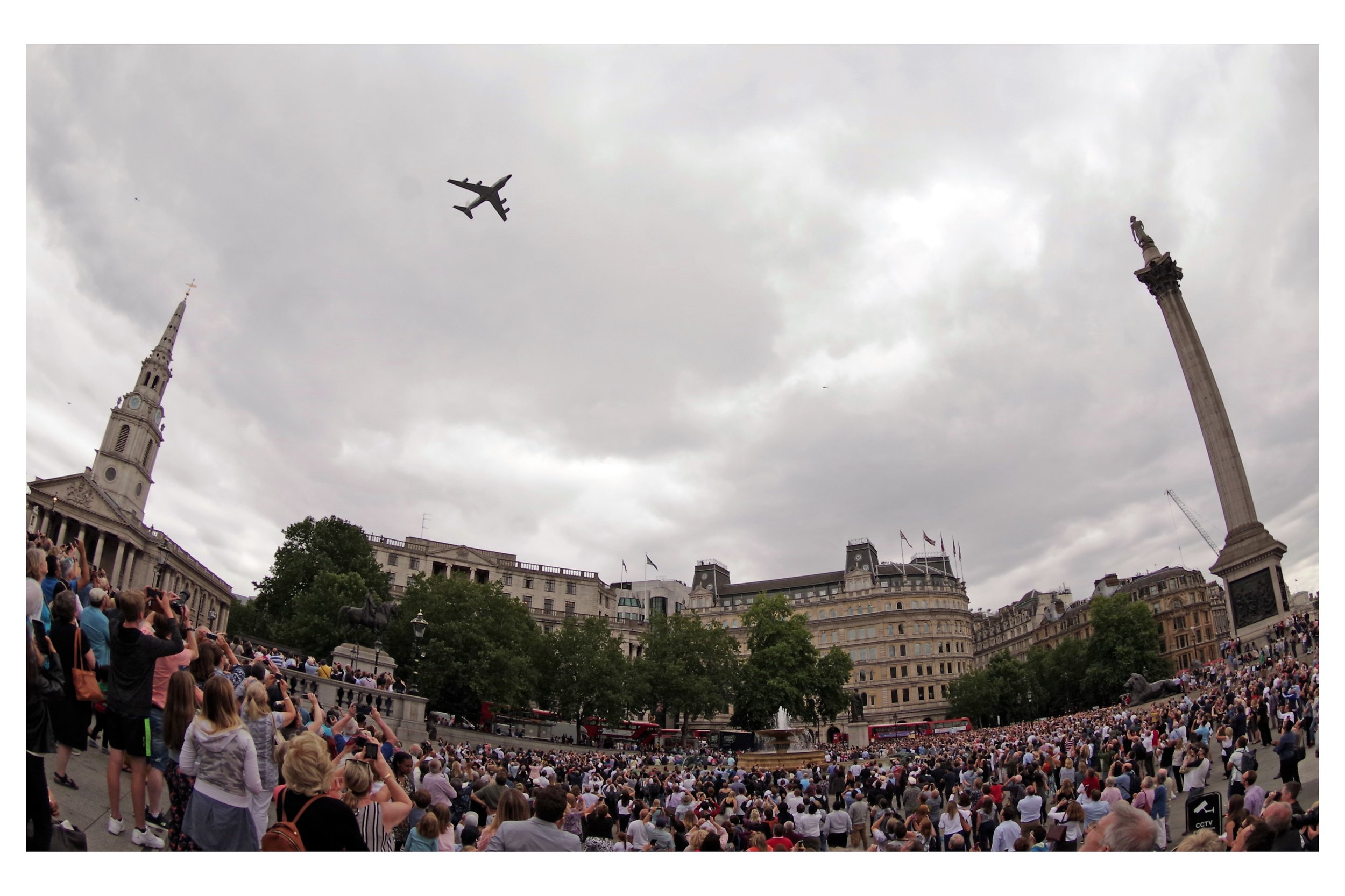 My last major position-shift brought near the top of the stairs where the crowds were most dense, but the planes' flight paths were most direct, plus I could frame the planes with Nelson's Column on the right and either that Church There (or the National Portrait Gallery) on the left.