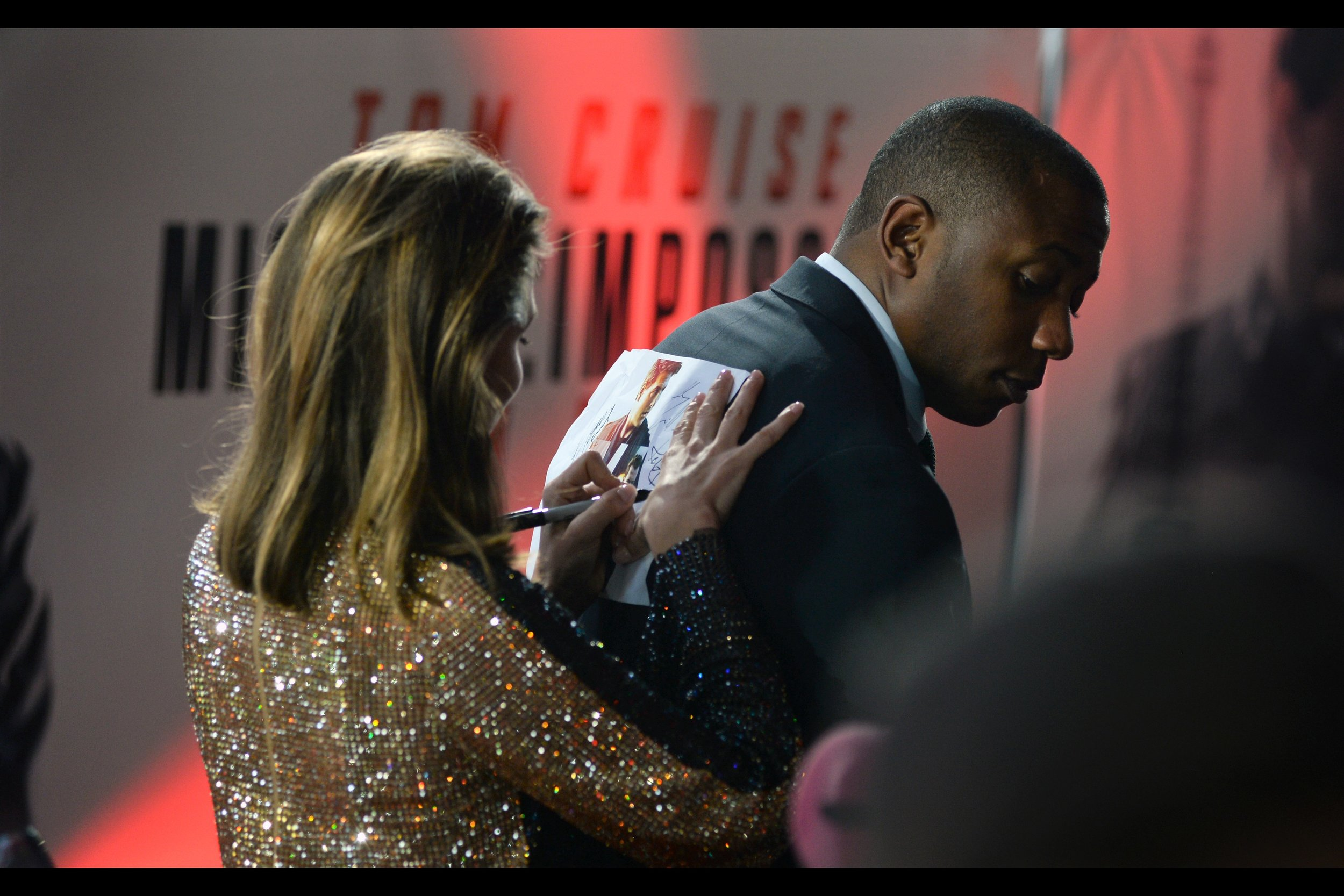 """""""Here's my phone number. As long as this guy's back isn't so sensitive that he can pick up what I'm writing by feel.... this should work""""  - Rebecca Ferguson was also recently in 'The Greatest Showman', 'The Snowman' and 'Life'.. but the only other time I've photographed her was at    the premiere of """"Florence Foster Jenkins""""    back in 2016."""