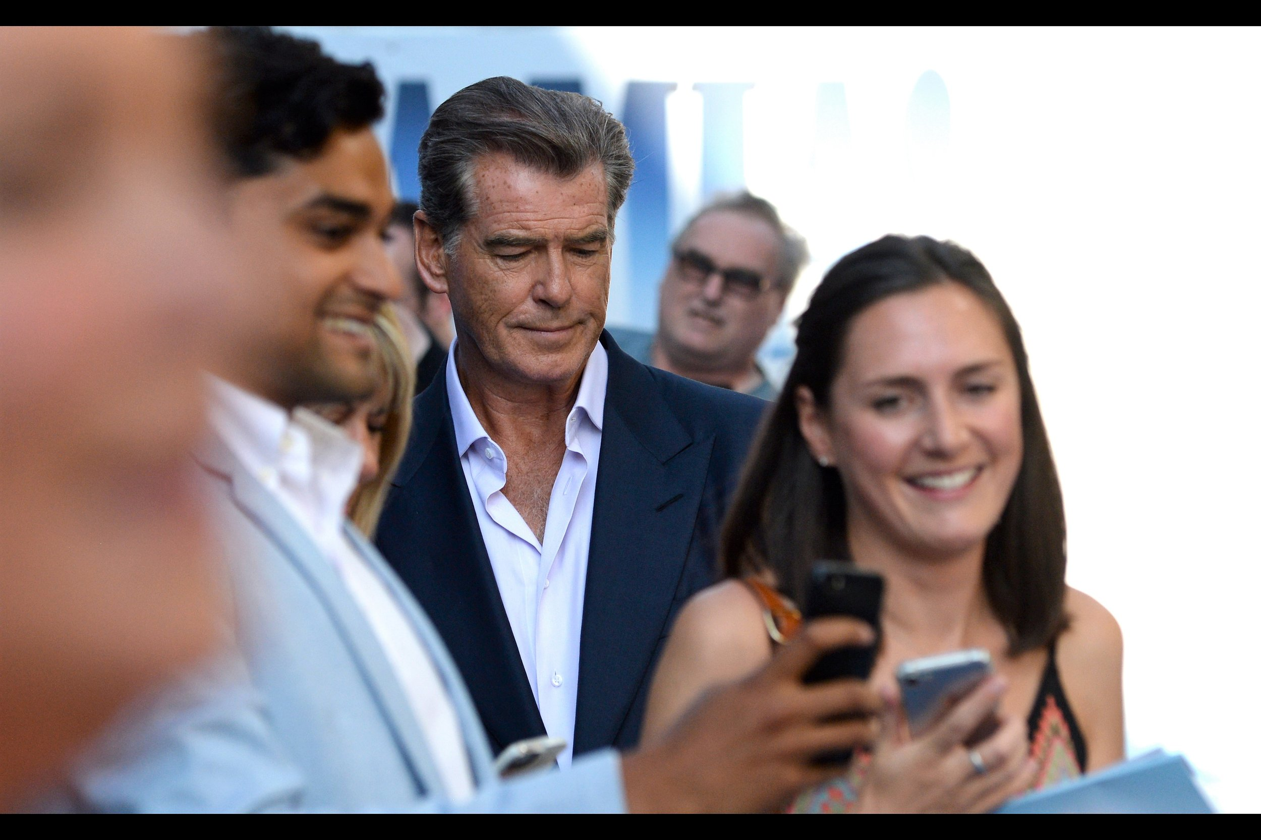 Pierce Brosnan played James Bond in Goldeneye, Tomorrow Never Dies, The World Is Not Enough, and Die Another Day.... but without seeing around to the other pen behind the media wall, I'm sure the dealers mostly wanted him to sign Dante's Peak merch. Those Volcano movies were big in the late 1990s...
