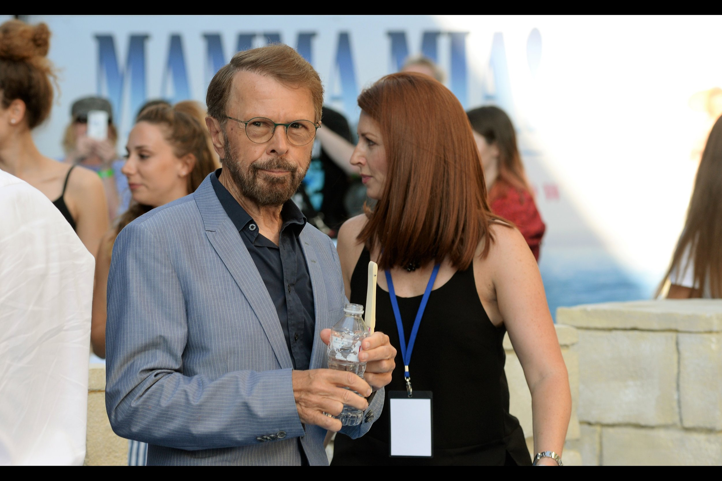 Bjorn Ulvaeus is one quarter of ABBA... and just like every single person so far, the girls to my right have used a combination of charm, desperation, and harmlessness to induce him to sign autographs. Their skills are pretty amazing.
