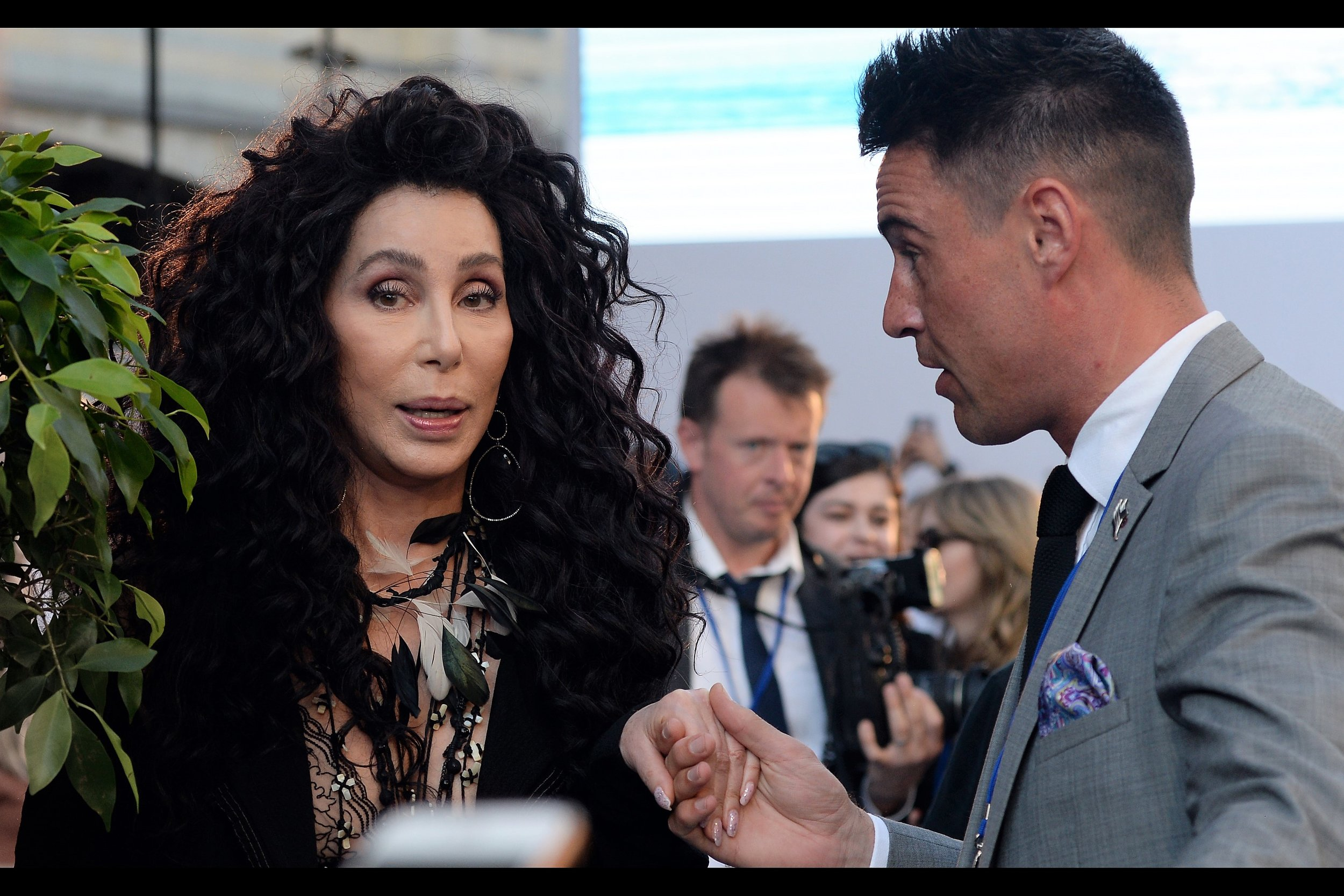 """Is that the guy with the website? He should publish in Magazines or Newspapers. Print is still profitable, right?""  It's Cher! She's won a Grammy (2000), an Oscar (Best Actress, Moonstruck (1987), AND an Emmy (2003) ... and apparently holds or held the Guinness Book Of World Records recorded for the Oldest person ever to have a #1 songs on the Billboard100."