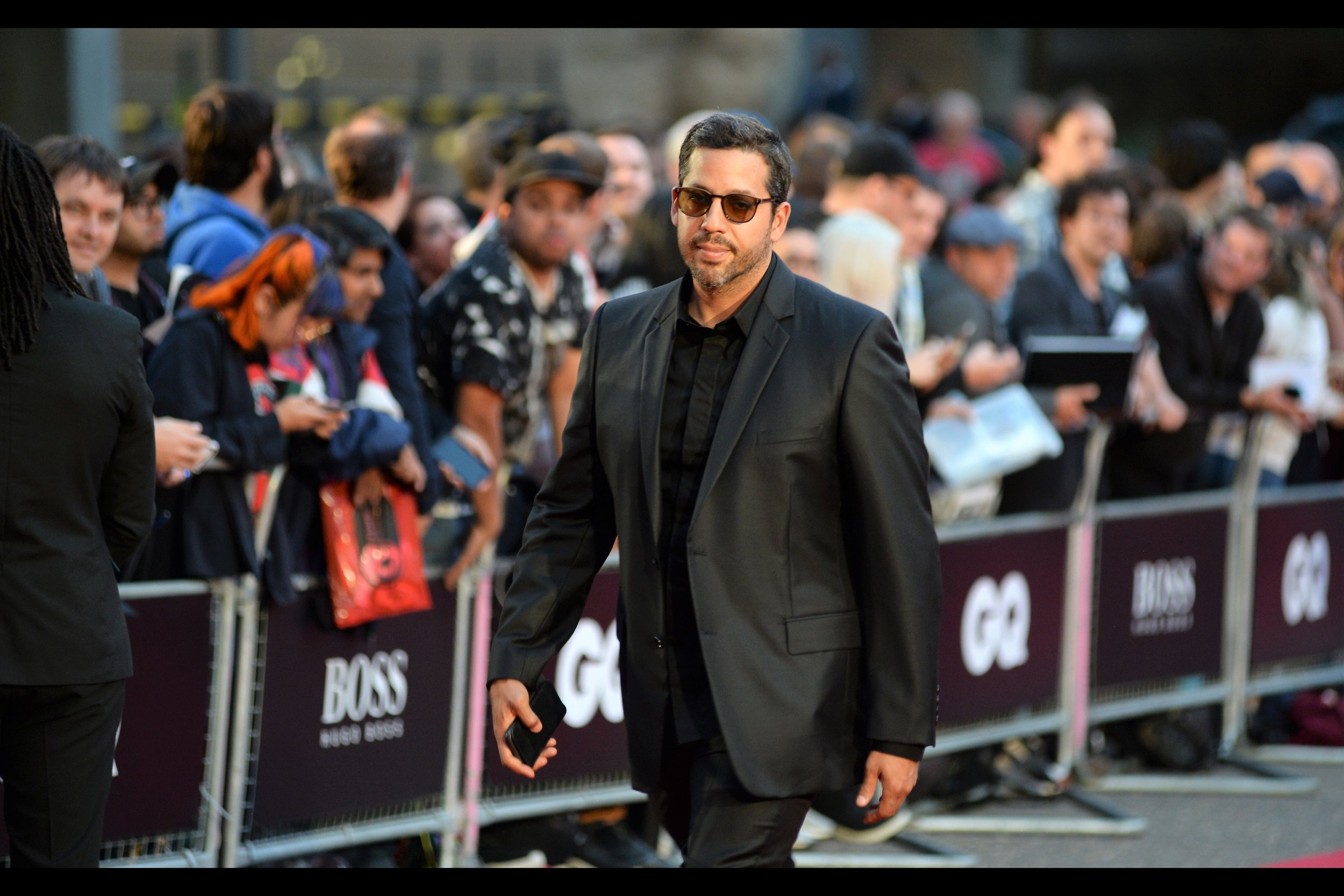 And when the time comes that a magician walks the carpet at the GQ Awards, it's a sign that it's time for me to disappear. (nb. he's David Blaine)
