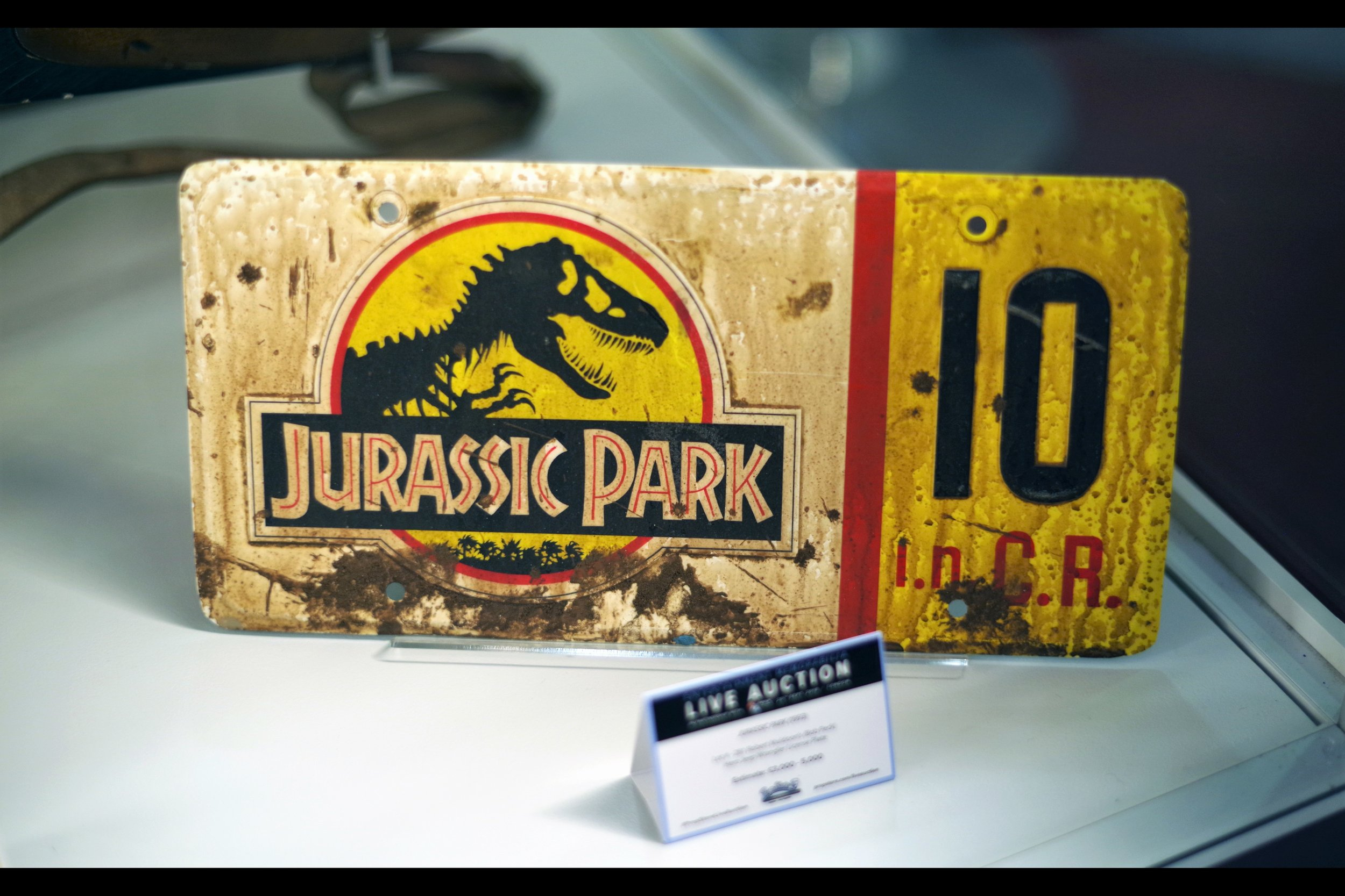 """""""No.. the dilophosaurus venom is on the other jeep's number plate""""  Muldoon's jeep wrangler number plate from Jurassic Park. Winning bid £9,000"""