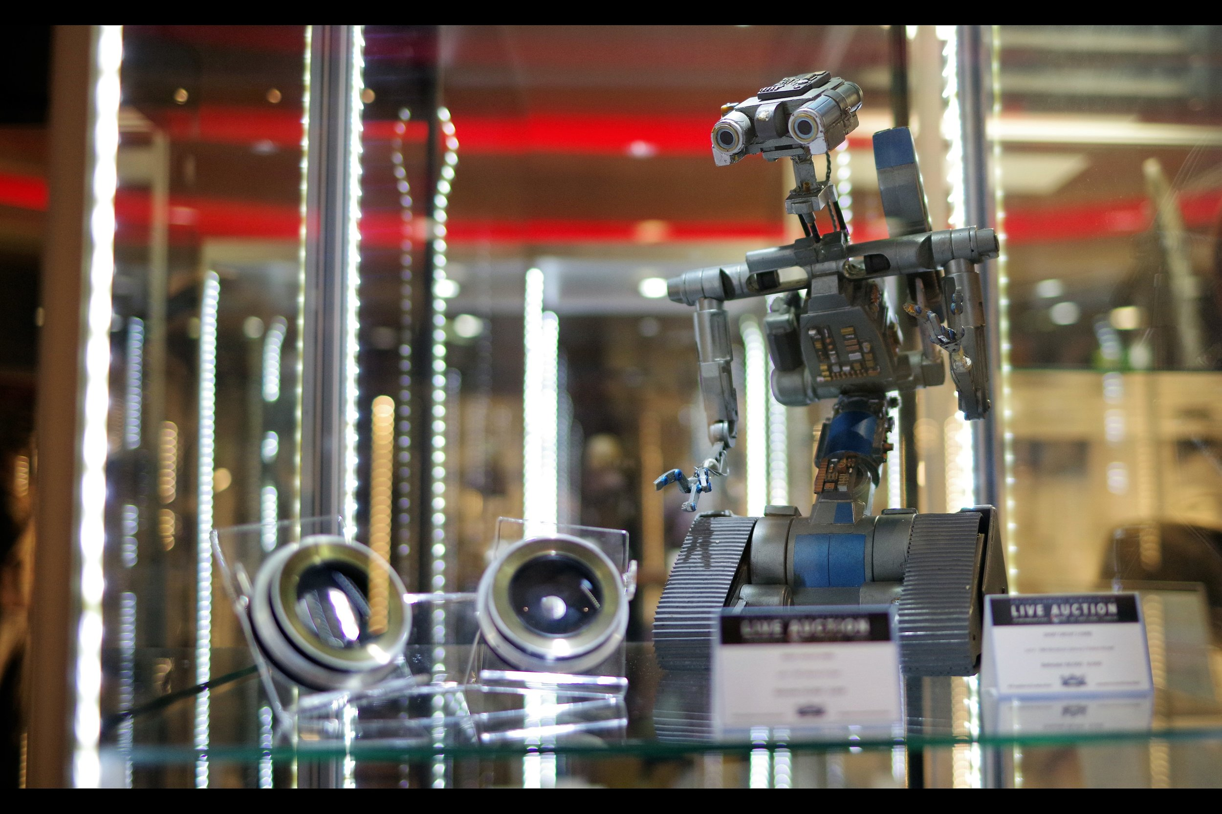 """""""But… if Johnny 5 is Alive, how is this auction even legal??""""  Johnny 5's eyes from Short Circuit. Winning bid: £2,000 Johnny 5 miniature from Short Circuit 2. Winning bid: £15,000"""