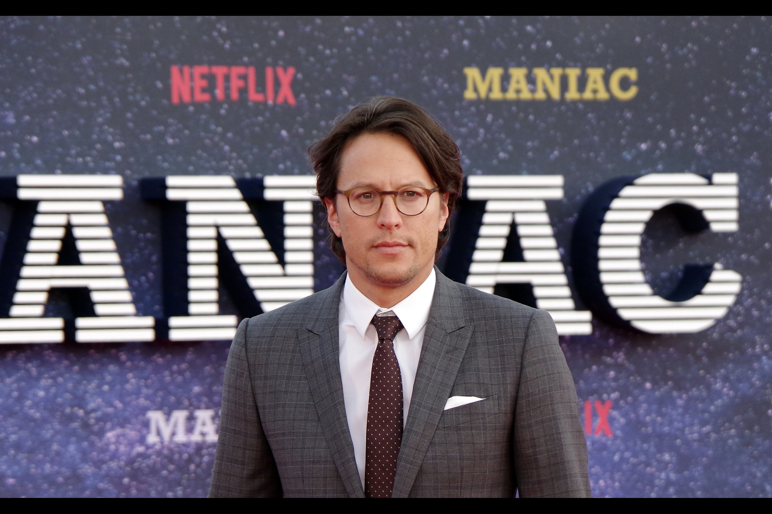 This is Cary Joji Fukunaga, who directed all ten episodes of 'Maniac', which also stars Jonah Hill. His eyes are presumably drawn to the fetching hat worn by the hairy paparazzo in front and to my right. Sadly, I myself am caught between seasons : it's too cool to wear my LA cap, and not cool enough to start bringing out my killer style beanies.