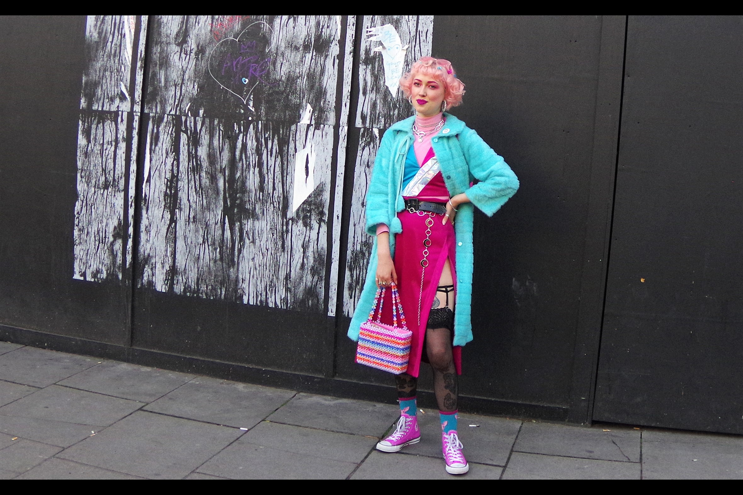 """""""The price of the ensemble I'm wearing is quite reasonable, and if you were to remove the street art behind me carefully enough, its sale would more than pay for it"""""""