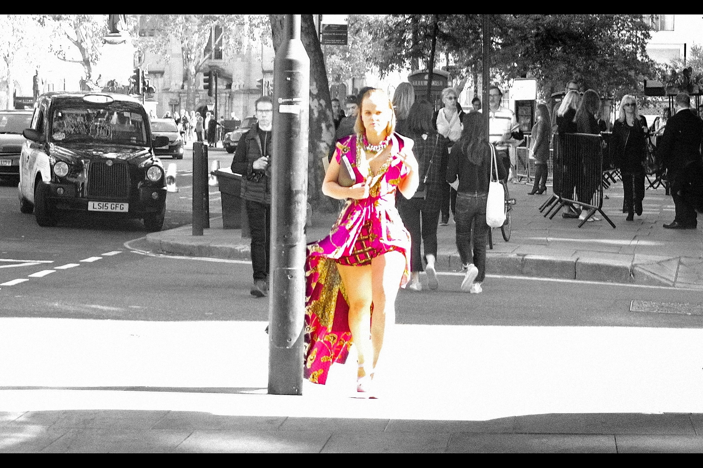 """""""If you were any kind of fashion photographer, you'd have waited until my dress had passed by the pole""""  … sure, but if you were any kind of model, you'd have known you'd be in the shade by the time the dress had passed. Feel free to critique my use of cheap selective desaturation, though…"""