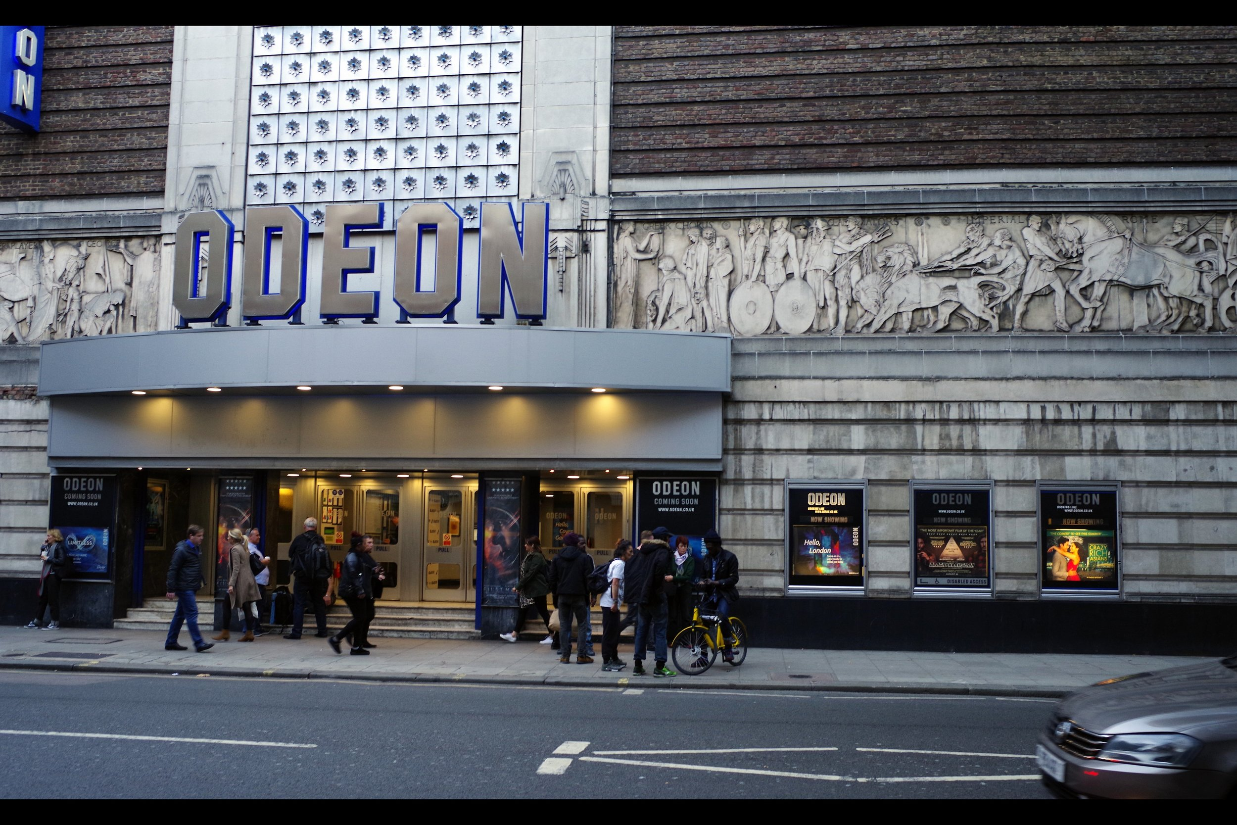 It's the Odeon Covent Garden. It's slightly closer to my office than Leicester Square is, and I already have a wristband for the pen of my choice for tomorrow's (apparently) gargantuan Lady Gaga premiere. So…. here it is. Nice frieze.