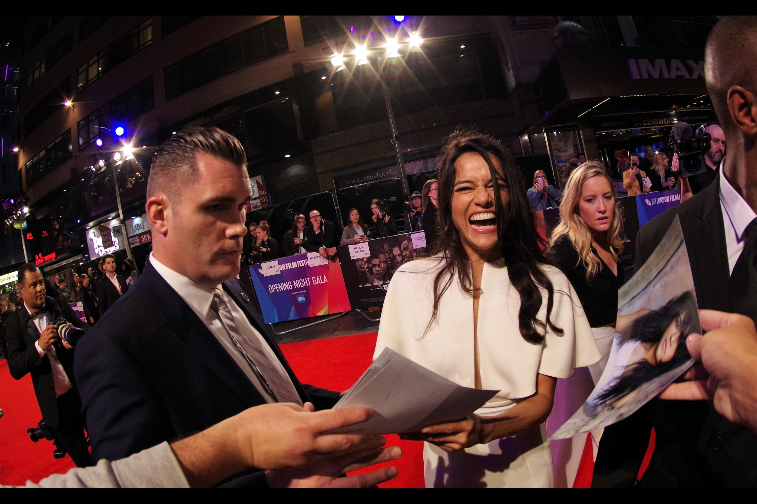 """""""That's Zoe Saldana… but sure I'll sign it!""""  - for an idea of the kind of madness this premiere has descended to on my side of the barrier : none of the hands coming from beneath and/or beside this photo are mine."""
