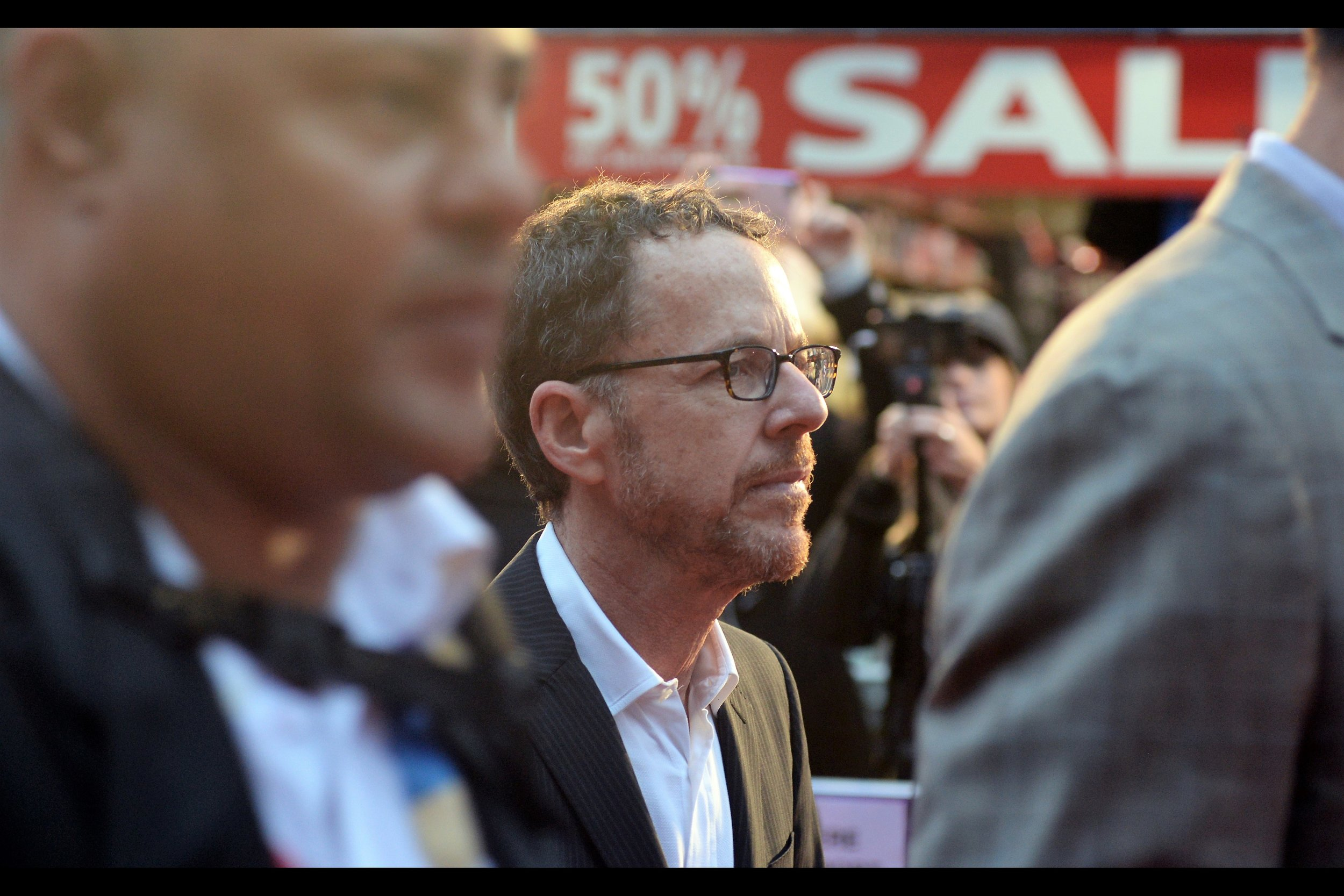 """It's only slightly better than a side-profile photo of Ethan Coen, but at least I did frame him against the increasingly iconic """" 50% SALE """" signs I've already photographed the likes of    director Steve McQueen    (and, a long time ago,    Bill Murray   ) in front of."""