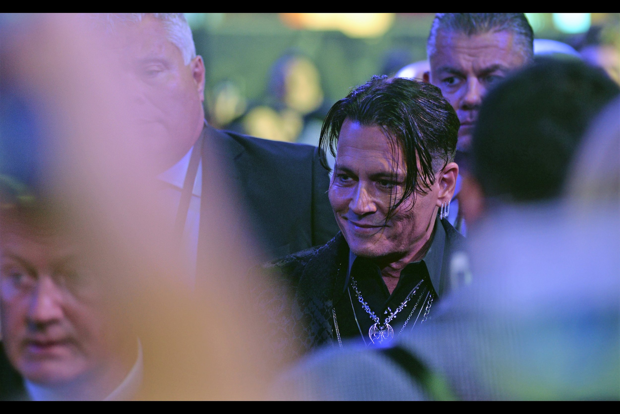 """You do realise the crowds you're trying to block are on the OTHER side of me?""   A thousand mobile phones go up in one hand, and pieces of paper to be signed in the other - it's Johnny Depp!"