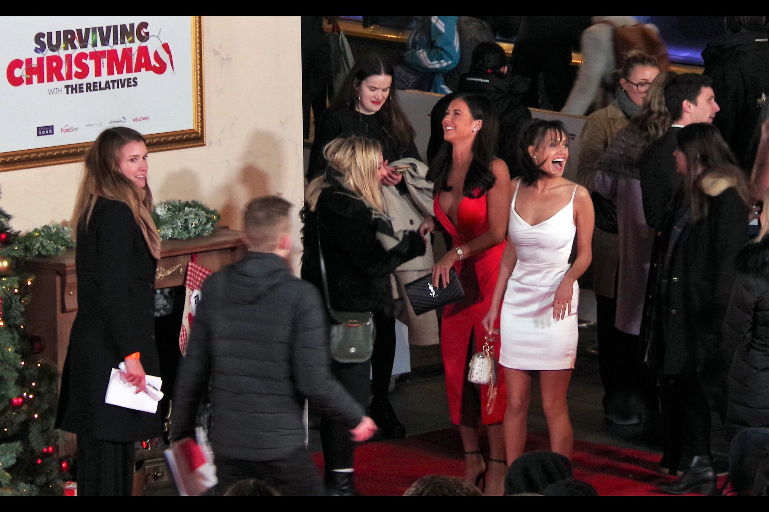 """She's wearing even less dress than I AM!!""  - yes, but wireimage identifies the red dress lady, not the white, as Shelby Tribble."