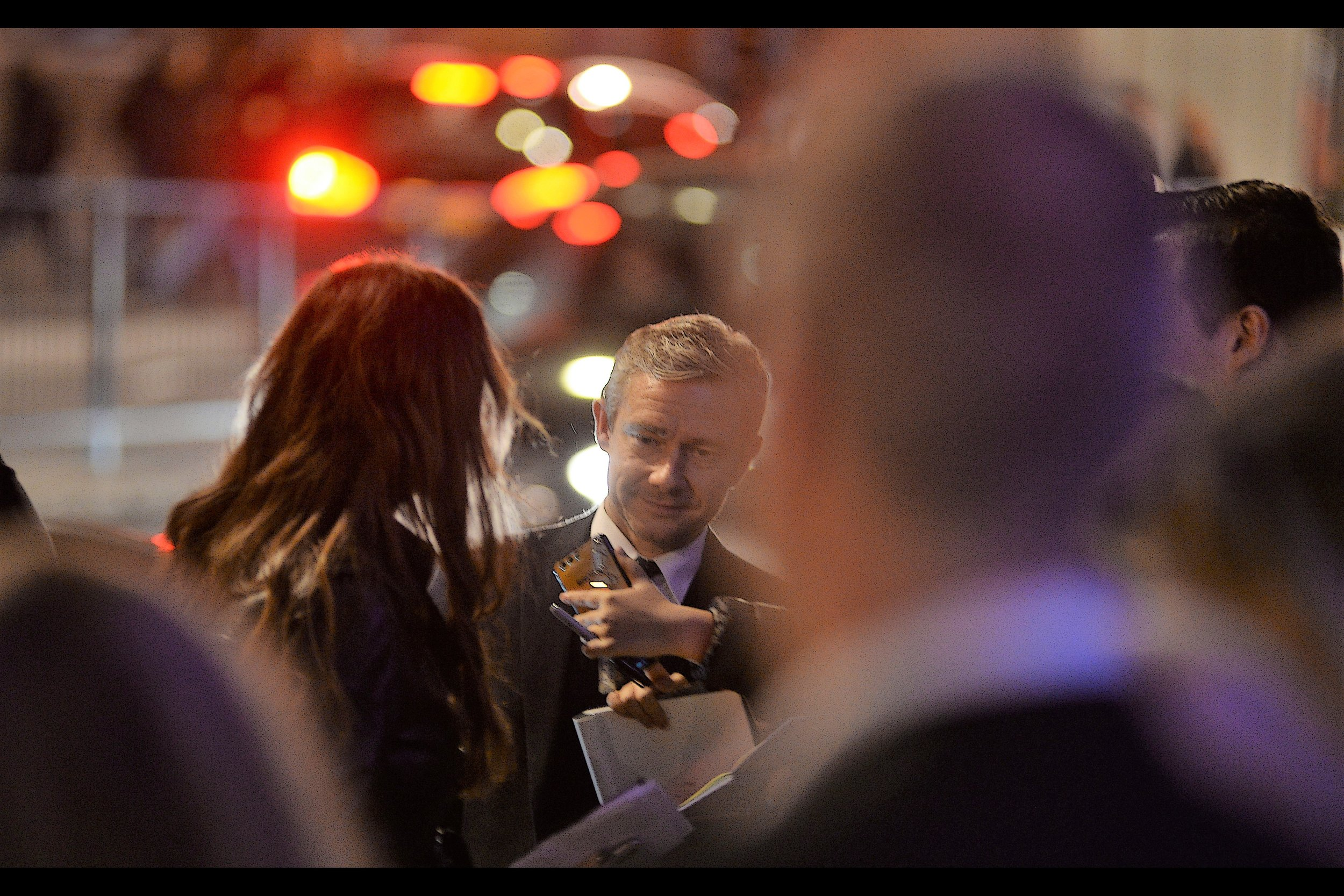 It's not the best photo of Martin Freeman I've ever taken (the one where he throws a pen in the air at last year's TV Baftas is) - but look at the sweet bokeh in the lights in the background! And, if that's your thing, the giant ear and head of the guy on the far right is pretty amazing too!