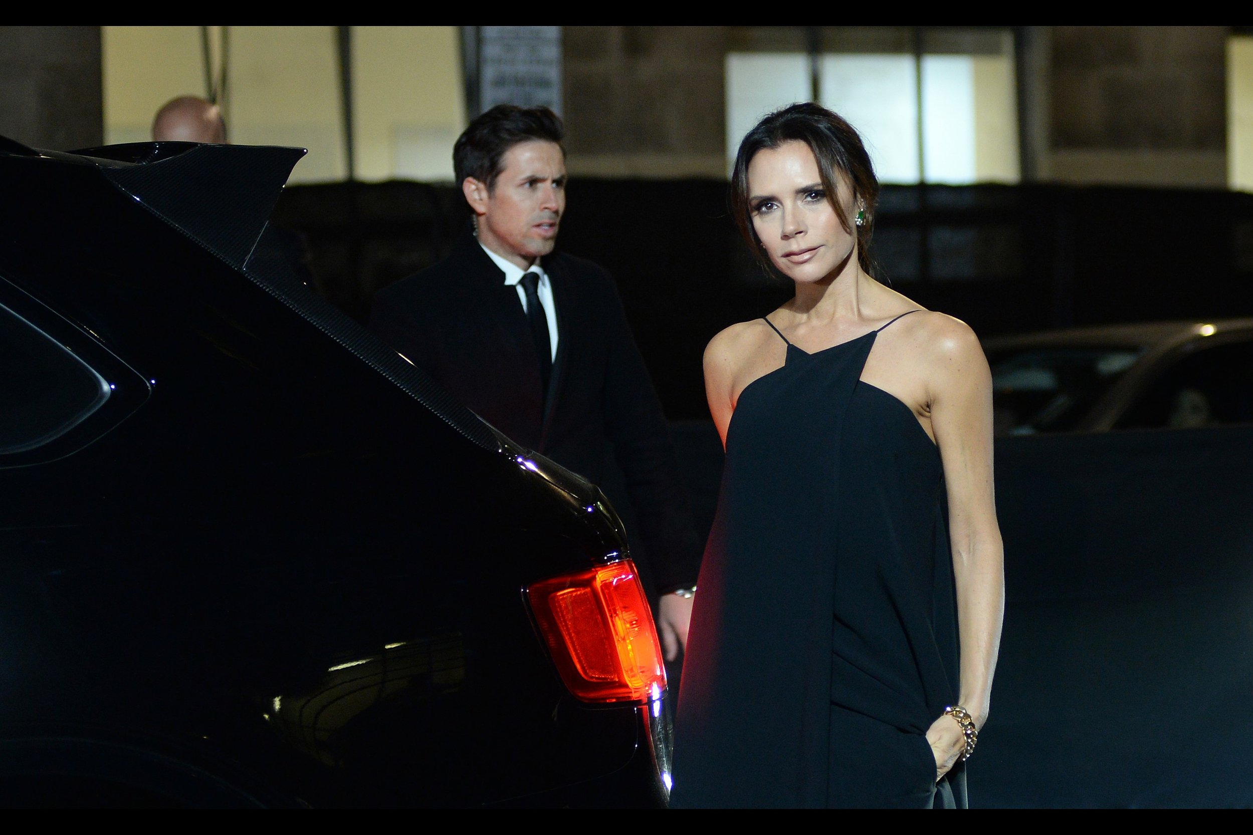This moment that Victoria Beckham and I are sharing…. continues. It's been going on for what seems like years, possibly decades. The guy in the background might be the grandson of the original chauffeur who drove her here, I don't know.