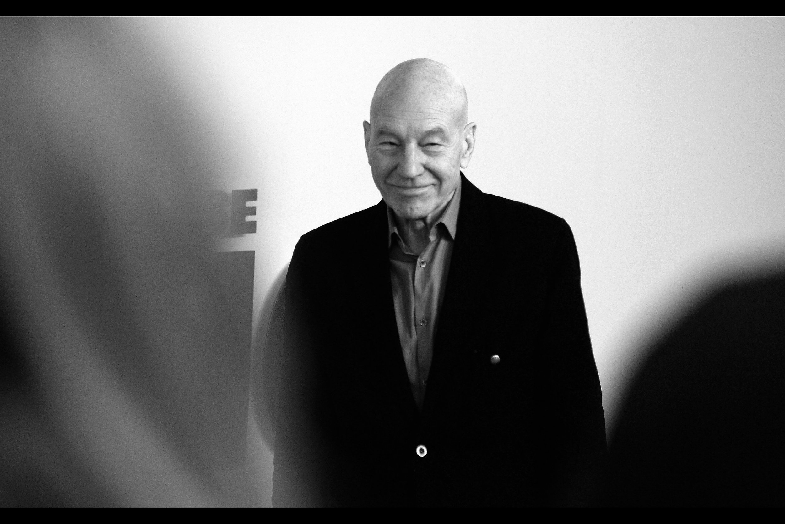 It's Sir Patrick Stewart ! - he's in this movie, and as long as this photo is the only thing required as evidence, he and I are great friends.