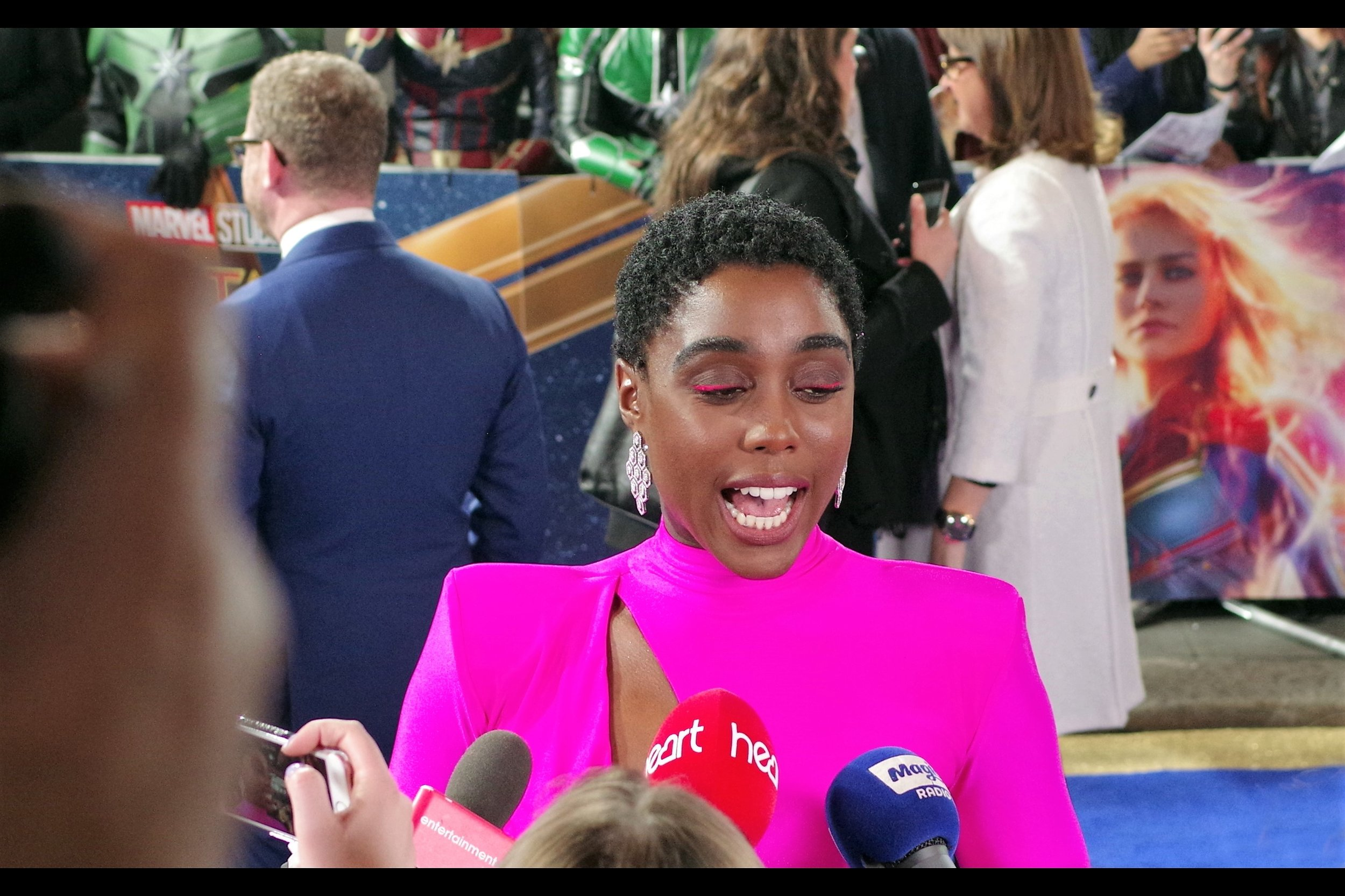 """People keep asking me about the colour of the dress and then looking away. What's that all about?""  - Lashana Lynch has been in a lot of TV series I haven't seen, and was in the movie ""Fast Girls"" whose premiere in 2012 I sadly missed. But I have now seen the dress she's wearing here, so I know what people are talking about when they mention it."