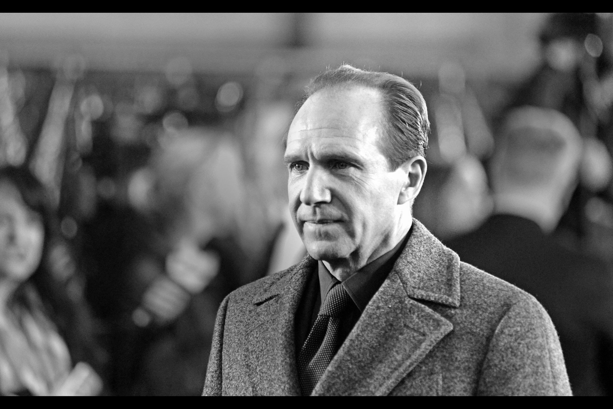 """I'm still looking at you… yes, you with that poster I signed""  Ralph Fiennes is arguably best known for being Voldemort in the Harry Potter films…  and he 's also the current incarnation of ""M"" in the Daniel Craig James Bond films."