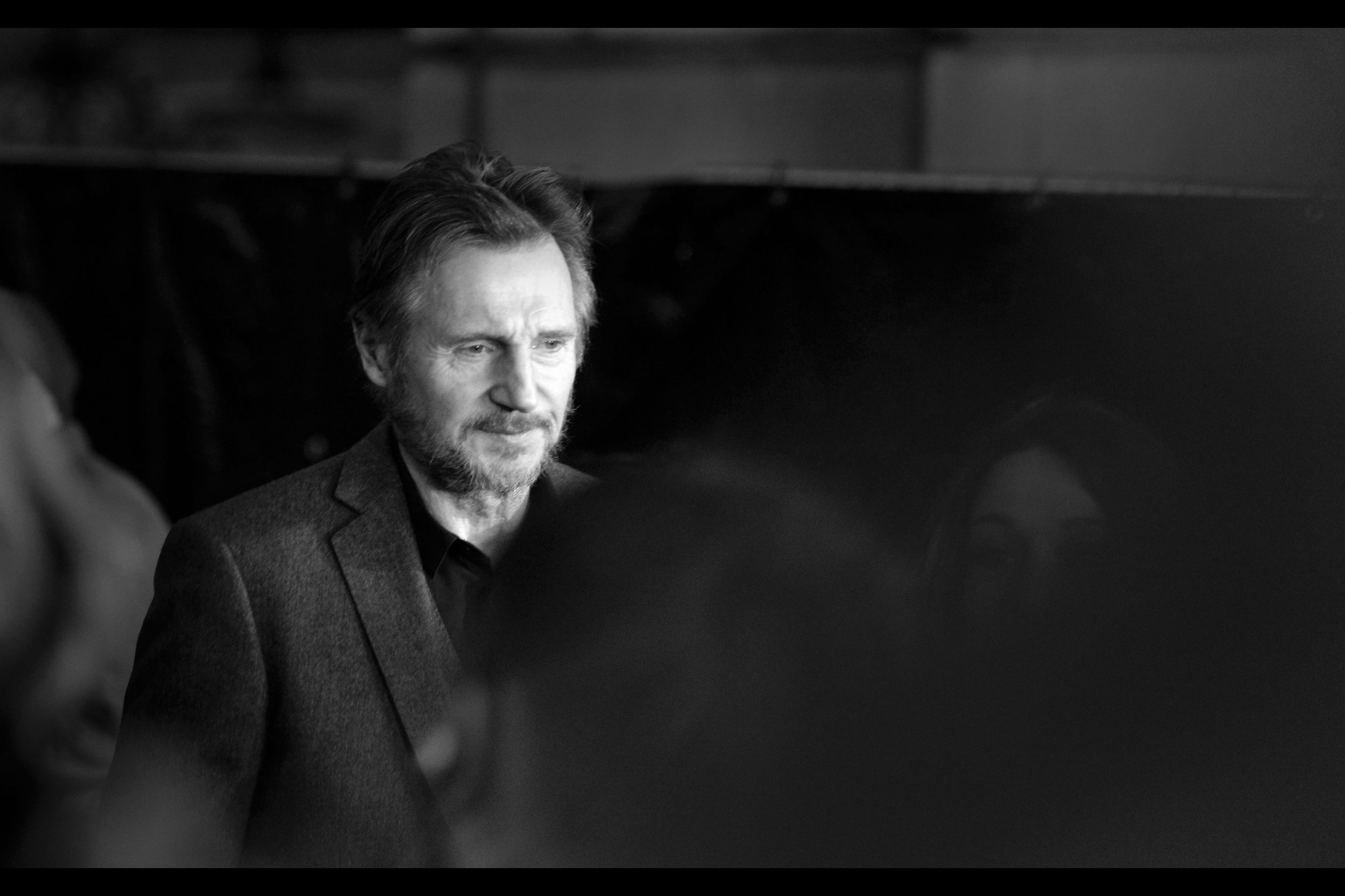 "It's Liam Neeson! Again, outside of the possibility that he's friends with Ralph Fiennes, they both starred in the unlikely duo of ""Schindler's List"" and ""The Lego Movie"" together. (Neeson is the voice of Good Cop/Bad Cop; while Fiennes is the voice of Lego Batman's butler Aflred)"