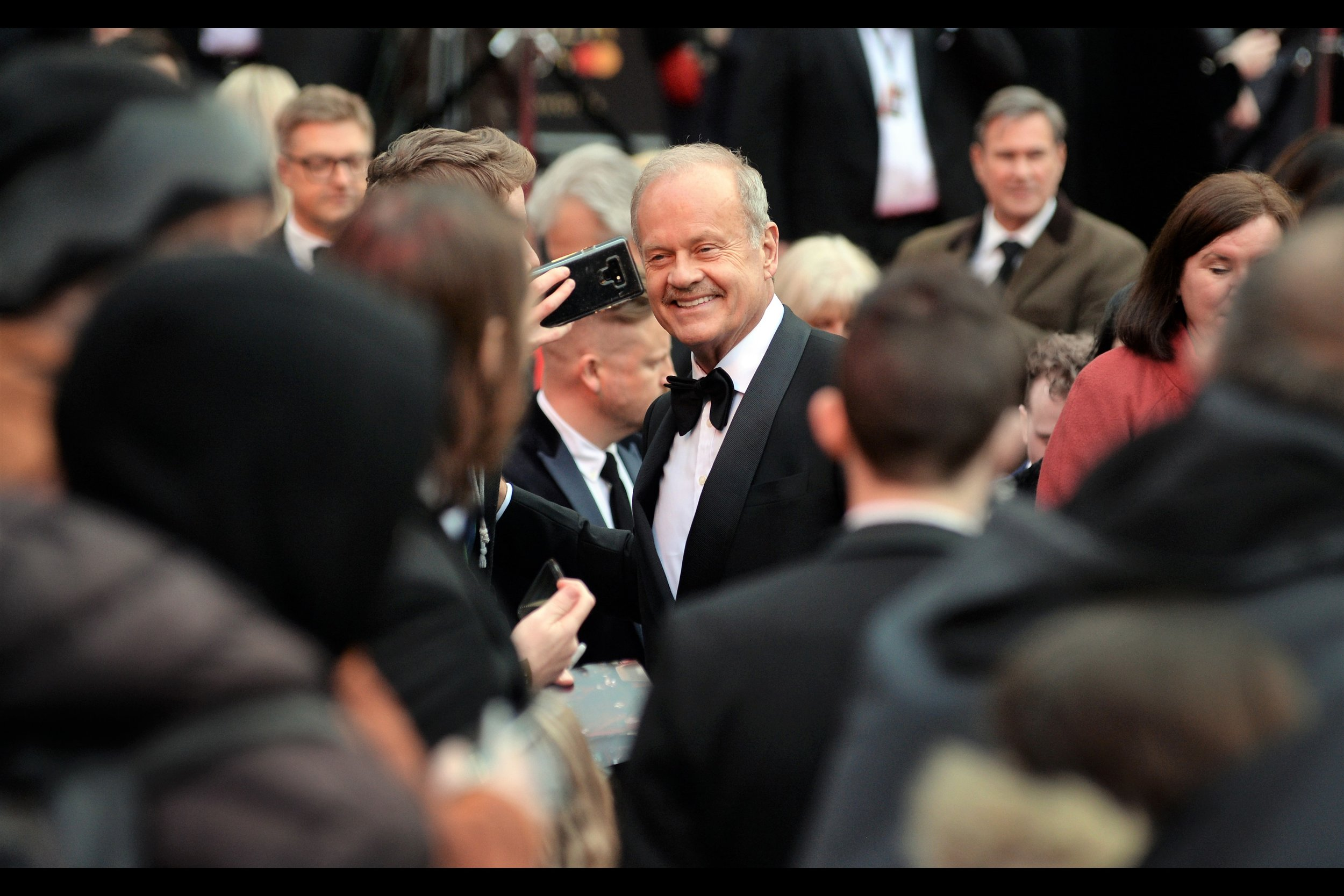 "It's Kelsey Grammer!! He played the character of Dr Frasier Crane for ten years and 203 episodes of ""Cheers"" from 1984-1993, before playing the same character in ""Frasier"" for another 263 episodes from 1993-2004. Of course, he was also Sideshow Bob in 21 episodes of The Simpsons across 27 years."