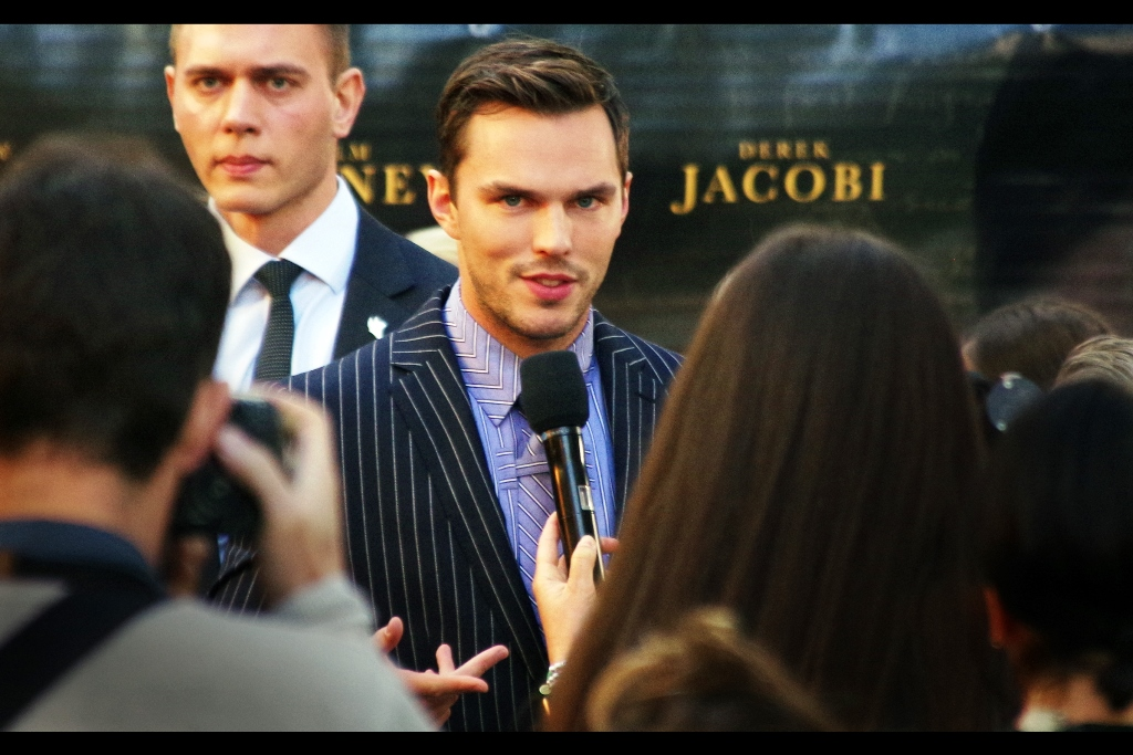 "At this distance, the pinstripes on Nicholas Hoult's suit are a very useful baseline for contrast-detect autofocus systems. Unfortunately, my Pentax's method is the more arcane and esoteric ""Phase Shift"", which seems to be based mostly on computational coin tossing. Still, it worked here."
