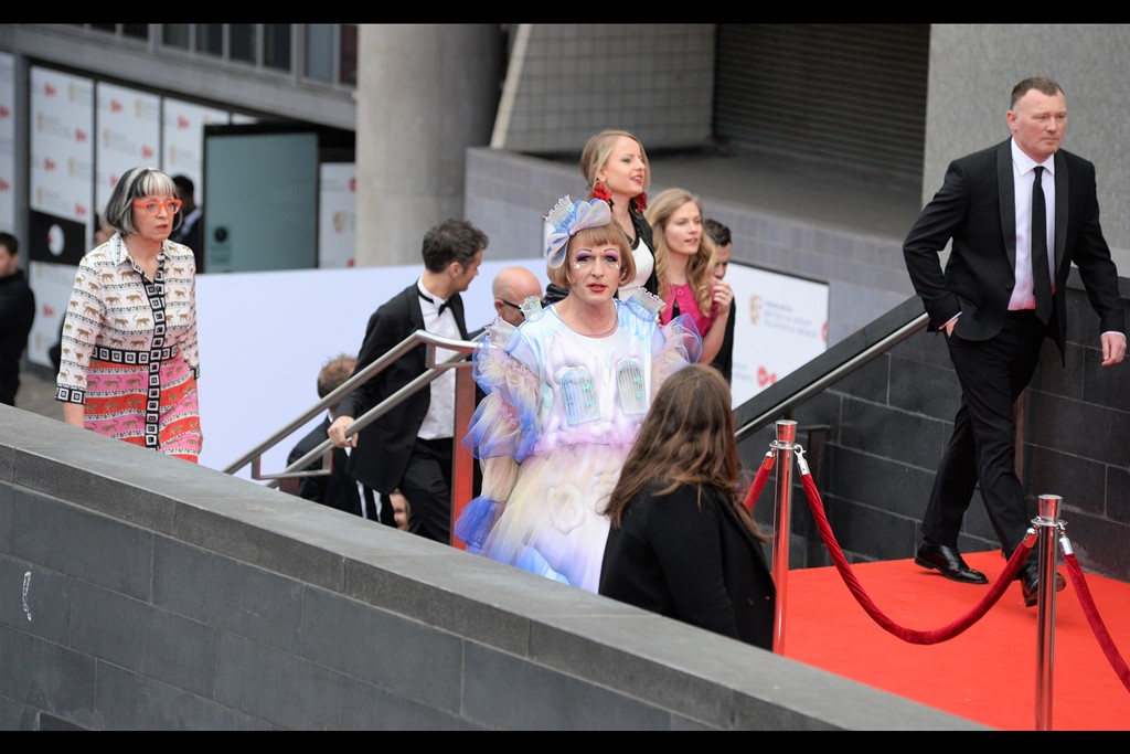 """""""That lady's hair is blocking views of my Art. If any of you have a sniper rifle and eliminate her, I can assure you the combined powers of the Art Community will rally behind you.""""  - I've forgotten who he is, but I also photographed him at this year's Olivier Awards. (edited to add : Grayson Perry)"""