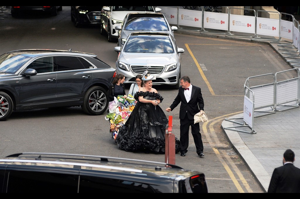 """As long as nothing falls off this dress, regardless of what it's made of I'm not littering, not even if I'm on the red carpet, you got that?""  - The dress may look like it needs a permit, but the lady wearing it is Daisy May Cooper, and she won the Best ""Writer: Comedy"" Bafta on the night."