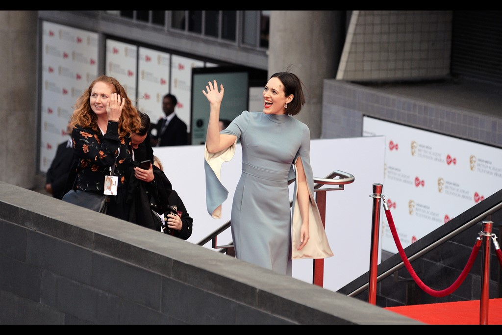 """The hem of one is lined with ceramic throwing weapons, and I'm using the other to smuggle in some snacks. But don't tell anyone"".  Phoebe Waller-Bridge's imdb entry is a bewildering combination of Writer, Actress and Producer across the spectrum of Television, Star Wars and the upcoming /most recent James Bond film."